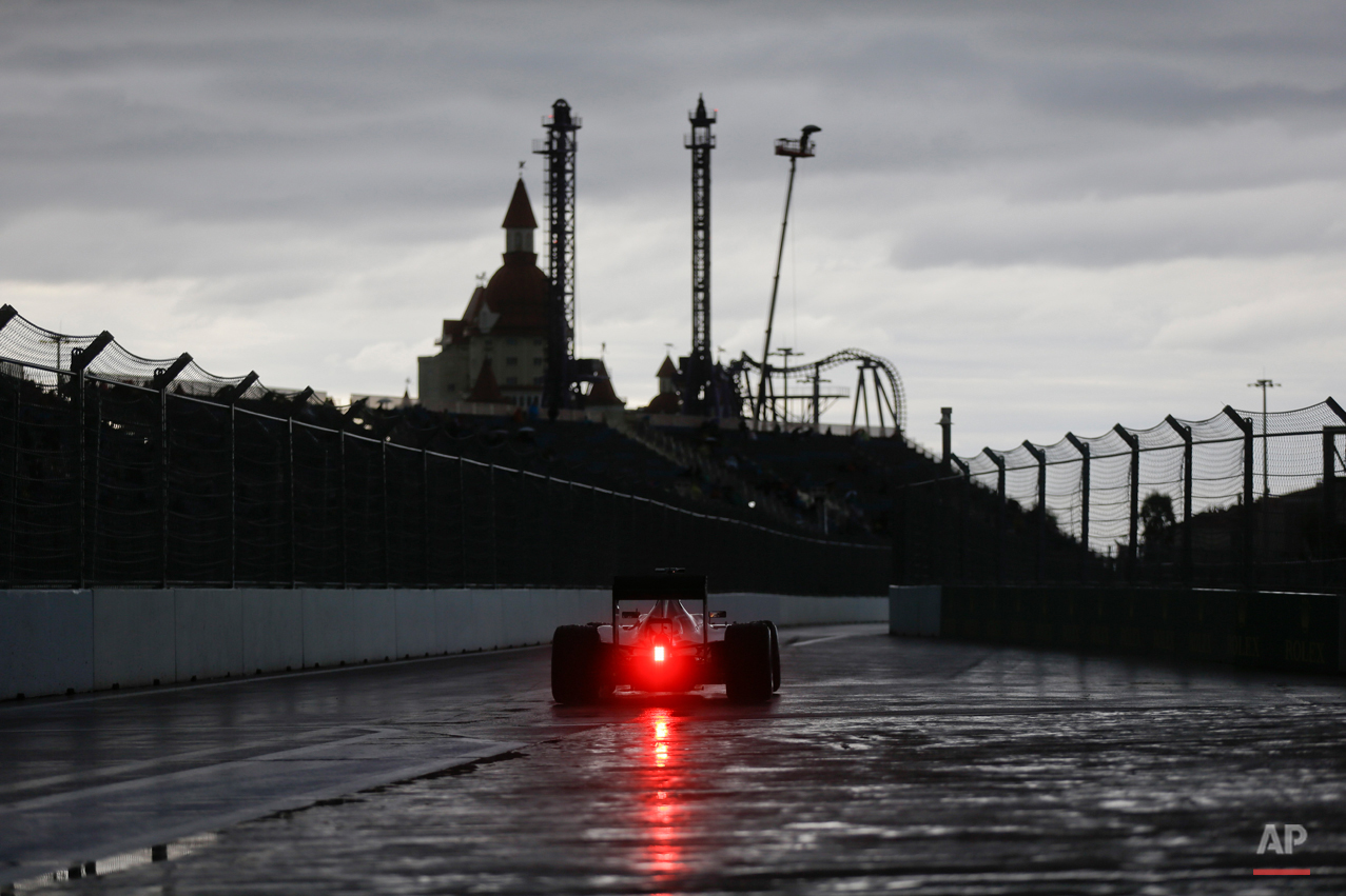 In this Oct. 9, 2015 photo, Mercedes driver Lewis Hamilton of Britain steers his car during the second free practice session at the 'Sochi Autodrom' Formula One track , in Sochi, Russia. (AP Photo/Luca Bruno)