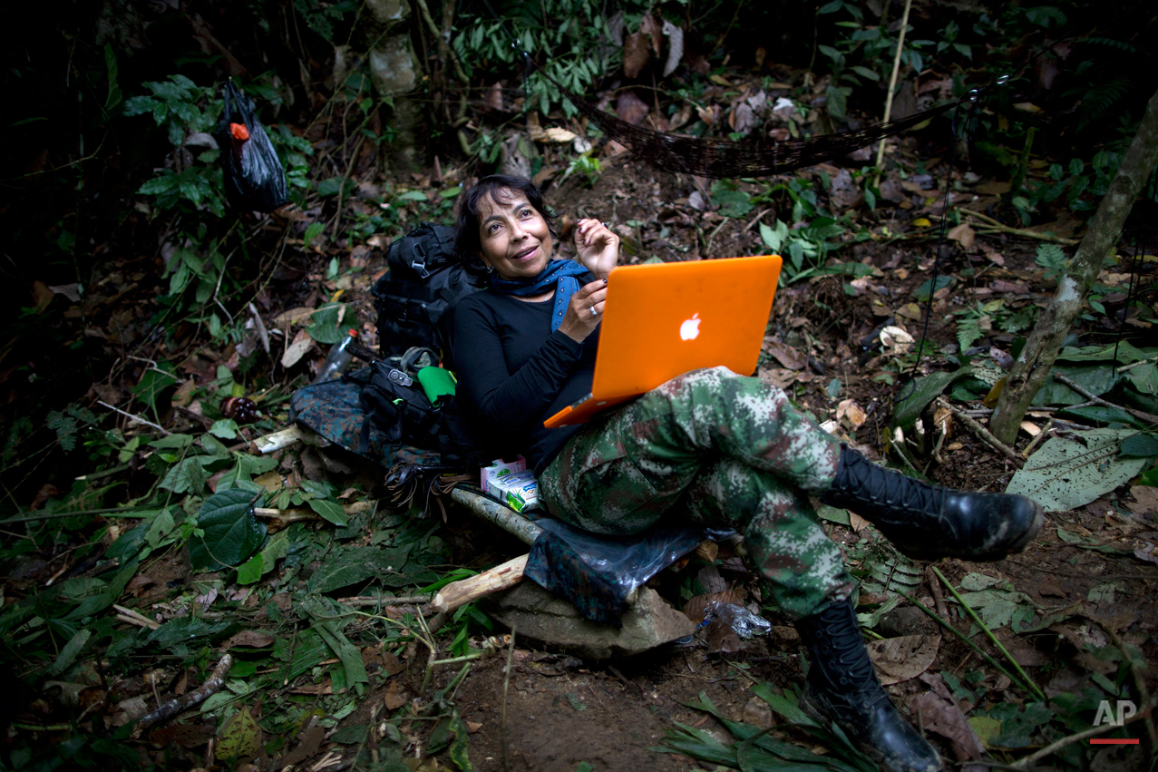 In this Jan. 4, 2016 photo, Yira Castro, a mid-level commander for the 36th Front of the Revolutionary Armed Forces of Colombia, or FARC, looks up from her laptop at a hidden camp in Antioquia state, in the northwest Andes of Colombia. After three decades in the jungle her loyalty is absolute, she says that if peace does arrive the first thing sheíll do is take a trip alone with her boyfriend, a fellow rebel.  (AP Photo/Rodrigo Abd)
