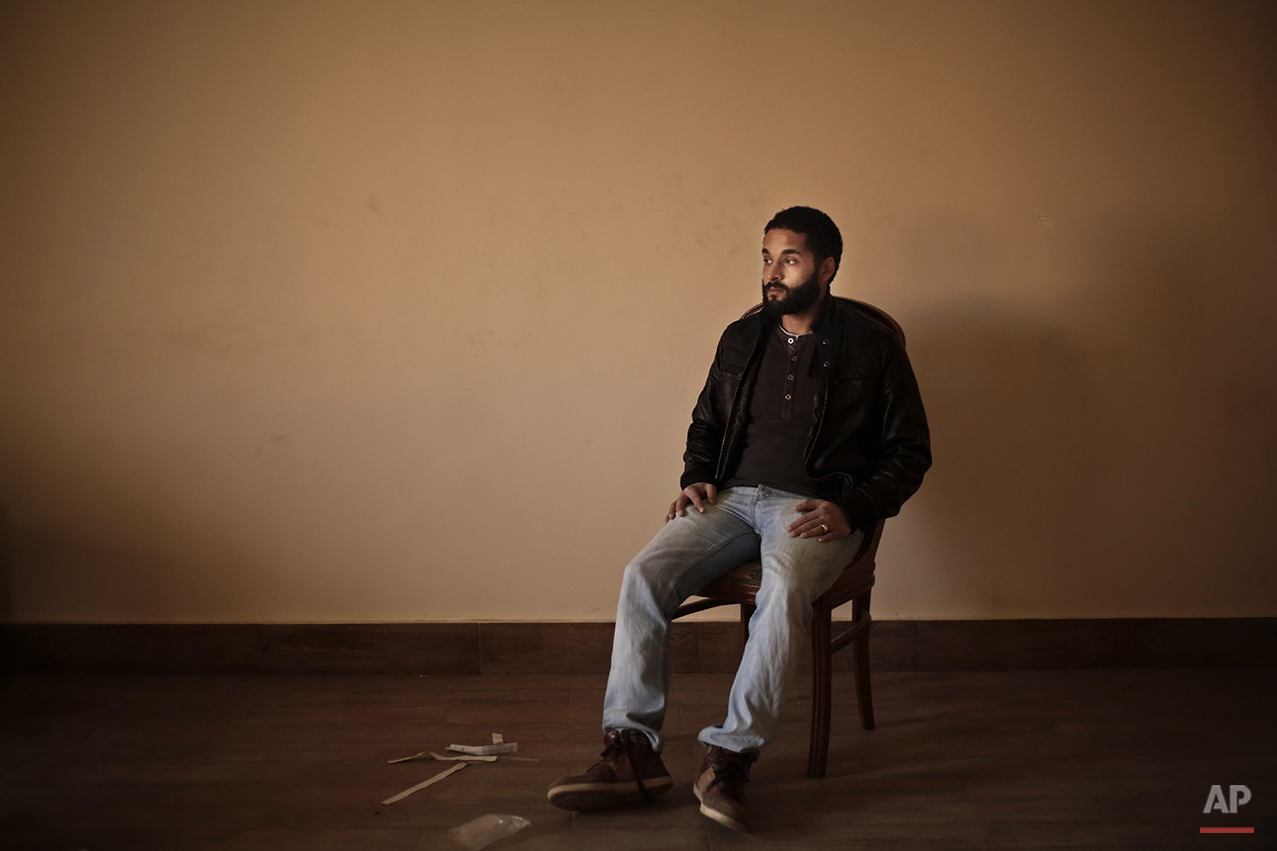 """Abdullah Dnewaor, a 28-year old Egyptian filmmaker, poses for a photograph in his home, during the fifth anniversary of the 2011 uprising, in Cairo, Egypt, Monday, Jan. 25, 2016. """"The Jan. 25 revolution was purer than what followed. Every year we regret the outcome. This is not what we wanted. We dreamed of a better Egypt but we were also very naive and did not understand fully what was going on. Egypt is home to the people in power and we are the guests. I want to leave the country because I do not see a bright future of my daughter,"""" says Dnewaor. (AP Photo/Nariman El-Mofty)"""