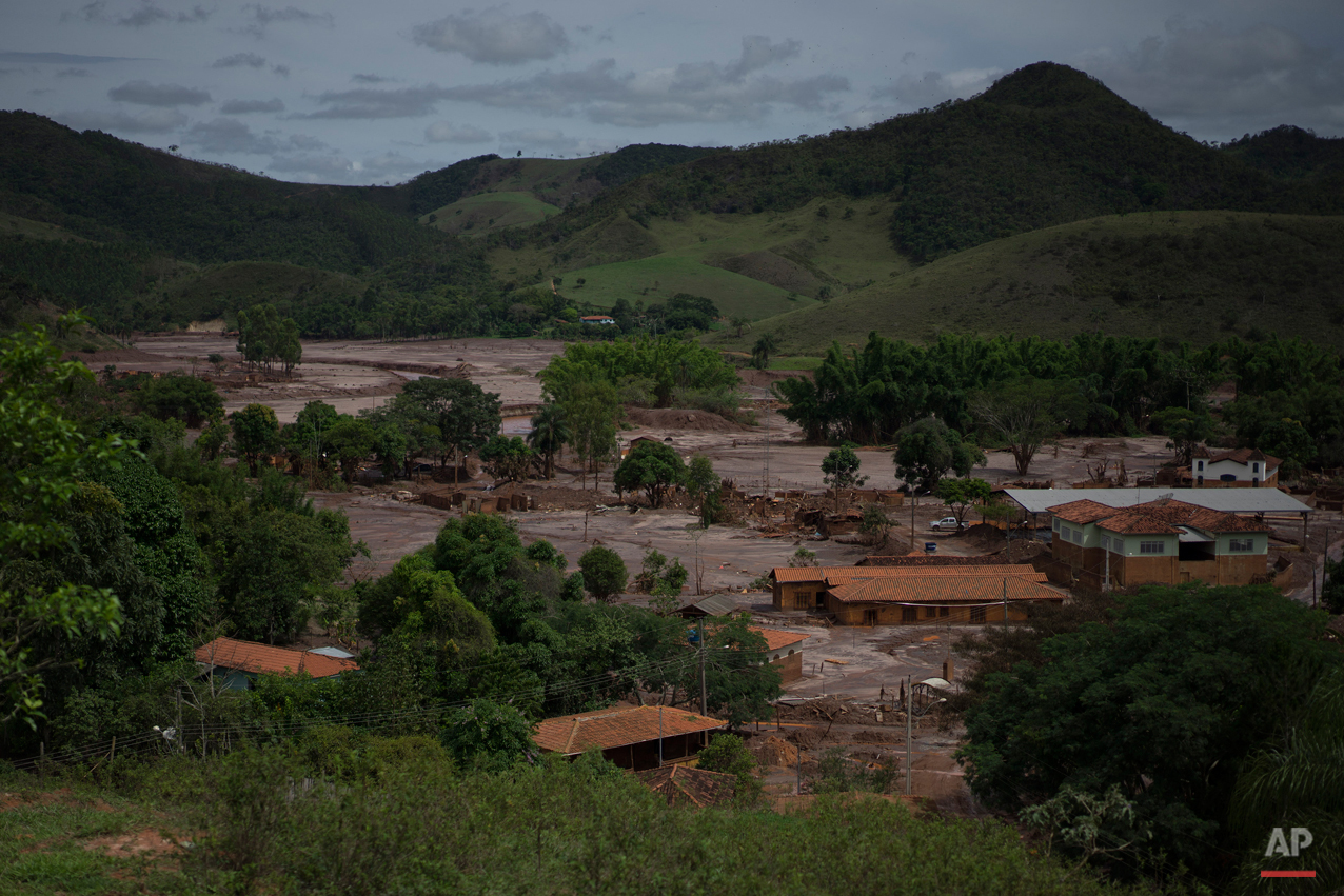This Nov. 24, 2015 photo, shows the destruction of the hamlet of Paracatu, Brazil, caused by an early November mudslide, triggered by the failing of a dam at a nearby iron ore mine. Now the area is a mud-slathered no-go-zones where there are few reminders of the lives people built here. (AP Photo/Leo Correa)