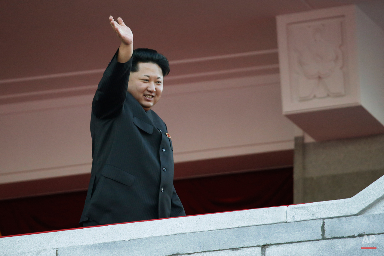 North Korean leader Kim Jong Un waves at a parade in Pyongyang, North Korea, Saturday, Oct. 10, 2015. North Korean leader Kim Jong Un declared that his country was ready to stand up to any threat posed by the United States as he spoke at a lavish military parade to mark the 70th anniversary of the North's ruling party and trumpet his third-generation leadership. (AP Photo/Wong Maye-E)