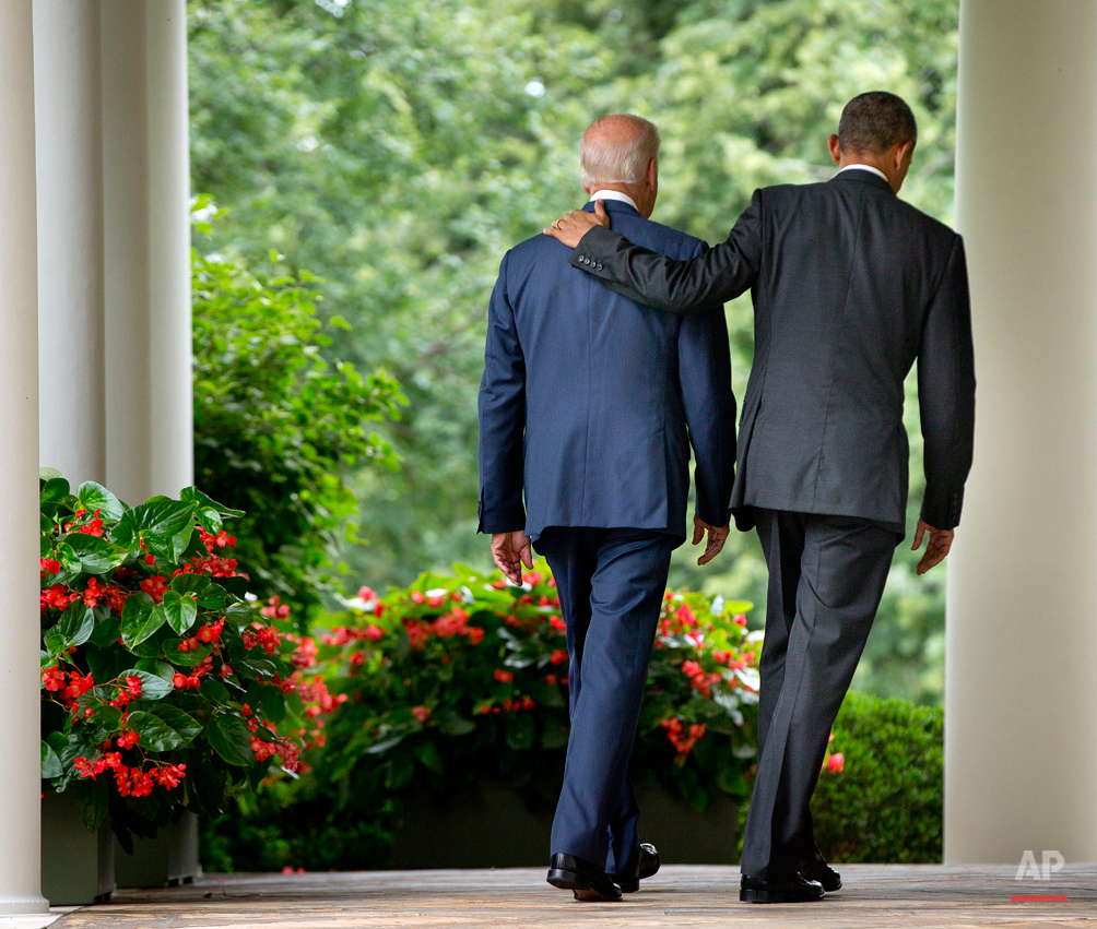 President Barack Obama walks with Vice President Joe Biden back to the Oval Office of the White House in Washington, Thursday, June 25, 2015, after speaking in the Rose Garden after the Supreme Court upheld the subsidies for customers in states that do not operate their own exchanges under President Barack Obama's Affordable Care Act. (AP Photo/Pablo Martinez Monsivais)