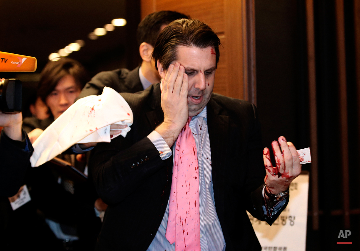 U.S. Ambassador to South Korea Mark Lippert leaves a lecture hall for a hospital in Seoul, South Korea, Thursday, March 5, 2015 after being attacked by a man. Lippert was attacked by a man wielding a razor and screaming that the rival Koreas should be unified. (AP Photo/Yonhap, Kim Ju-Sung, File) KOREA OUT