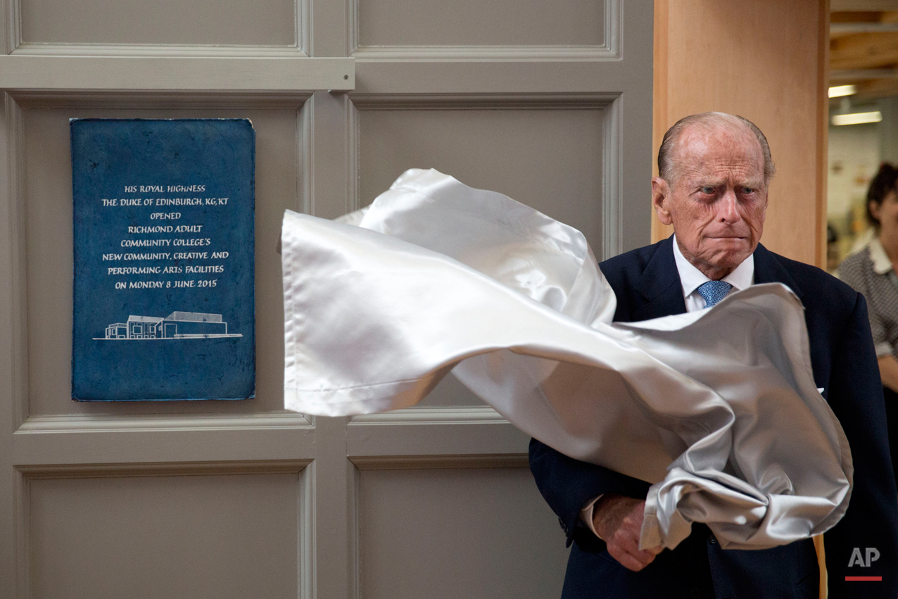 Britain's Prince Philip, the husband of Queen Elizabeth II, unveils a plaque at the end of his visit to Richmond Adult Community College in Richmond, south west London, Monday, June 8, 2015. The Prince officially opened and was shown around the new art, drama and dance facilities at the further education college which offers up to 2,000 courses. (AP Photo/Matt Dunham, Pool)