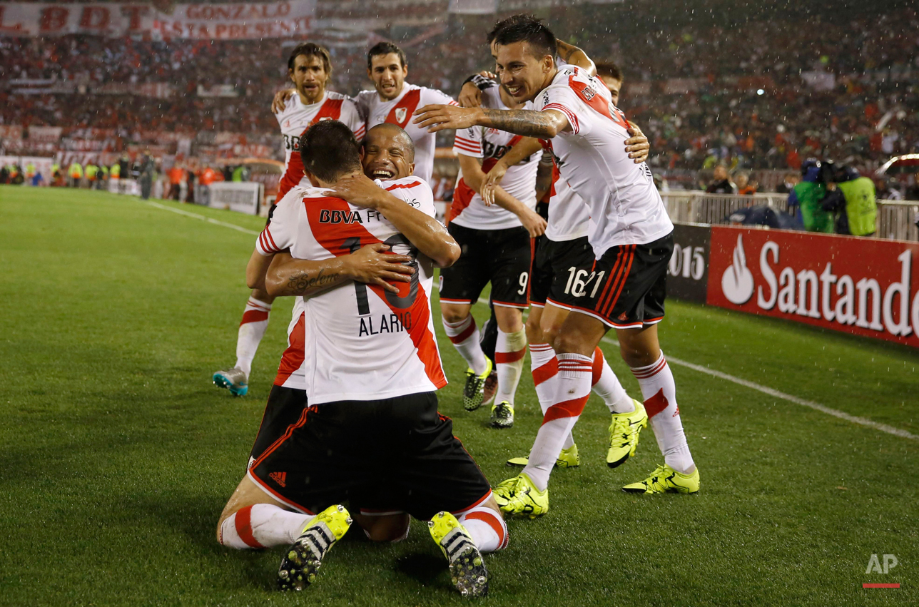 Lucas Alario, center back to camera, of Argentina's River Plate celebrates with his teammates after scoring against Mexico's Tigres during the Copa Libertadores final soccer match in Buenos Aires, Argentina, Wednesday, Aug. 5, 2015.(AP Photo/Ivan Fernandez)