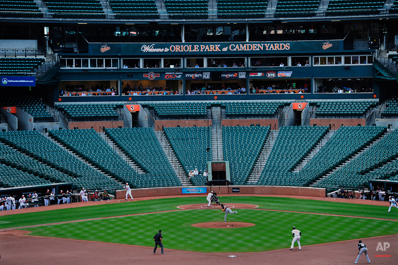 The Baltimore Orioles bat against the Chicago White Sox during a baseball game without fans Wednesday, April 29, 2015, in Baltimore. Due to security concerns the game was closed to the public. (AP Photo/Gail Burton)