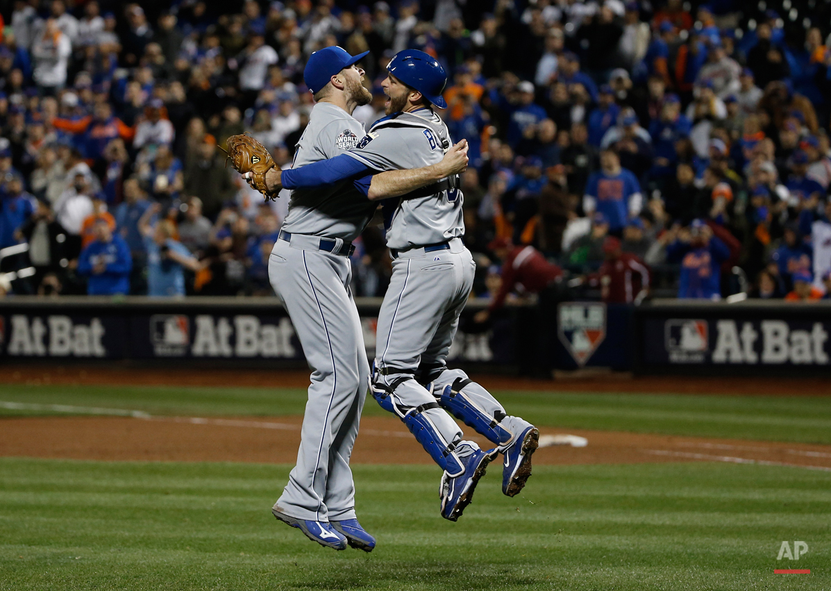 Kansas City Royals pitcher Wade Davis (17) celebrates with Drew Butera after Game 5 of the Major League Baseball World Series against the New York Mets Monday, Nov. 2, 2015, in New York. The Royals won 7-2 to win the series. (AP Photo/Matt Slocum)