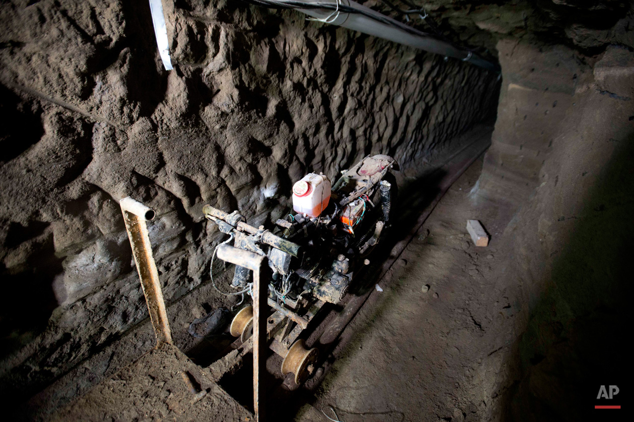 "In this July 14, 2015, photo, a motorcycle adapted to a rail sits in the tunnel under the half-built house where according to authorities, drug lord Joaquin ""El Chapo"" Guzman made his escape from the Altiplano maximum security prison in Almoloya, west of Mexico City. A widespread manhunt that included highway checkpoints, stepped up border security and closure of an international airport failed to turn up any trace of Guzman after he escaped through an underground tunnel in his prison cell. (AP Photo/Eduardo Verdugo)"