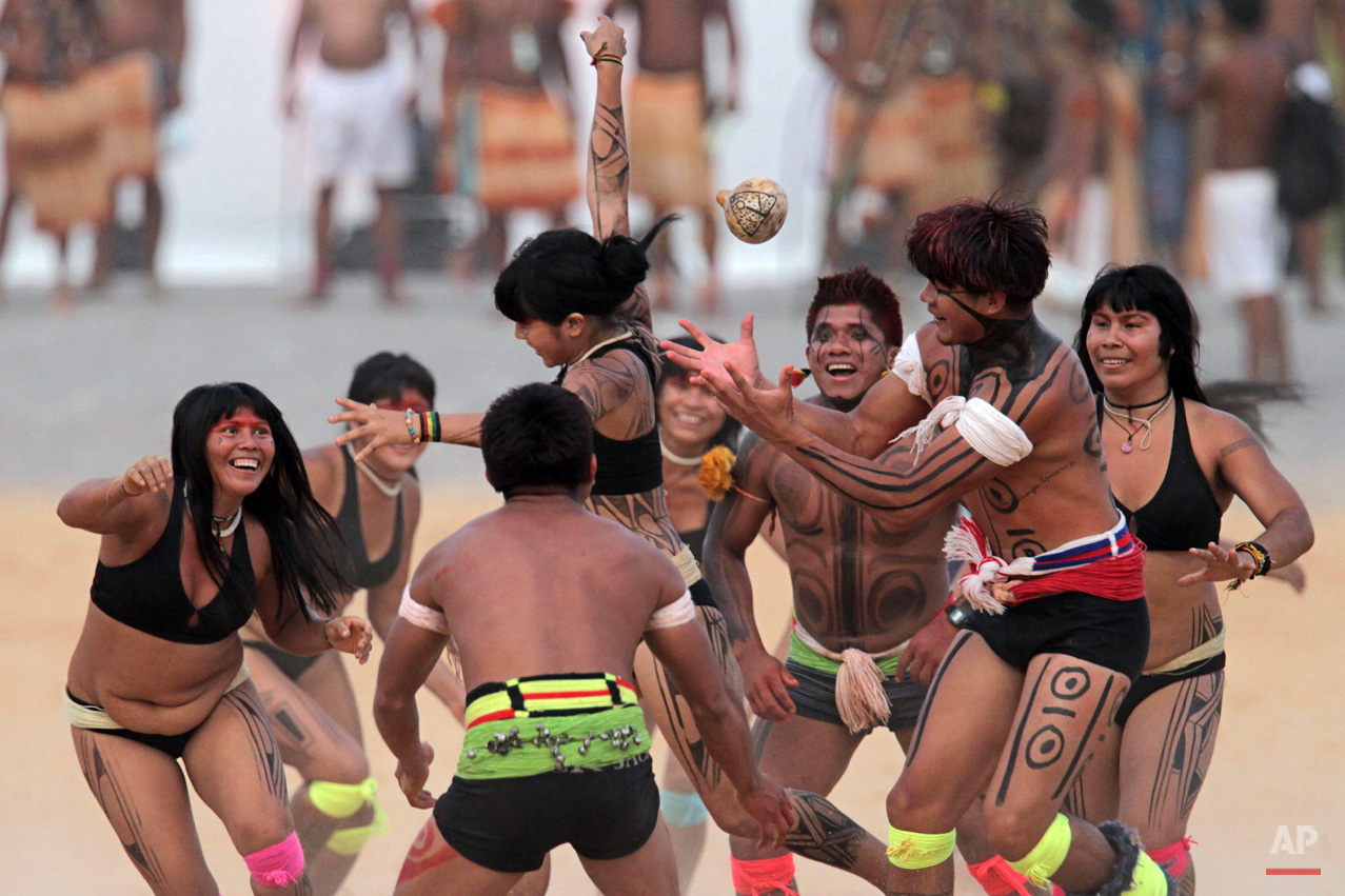 In this Oct. 29, 2015, photo, Brazilís Kamayura indigenous people take part in a ball game with hands during the World Indigenous Games in Palmas, Brazil. Organizers billed the nine-day-long event as a sort of indigenous Olympics. (AP Photo/Eraldo Peres)
