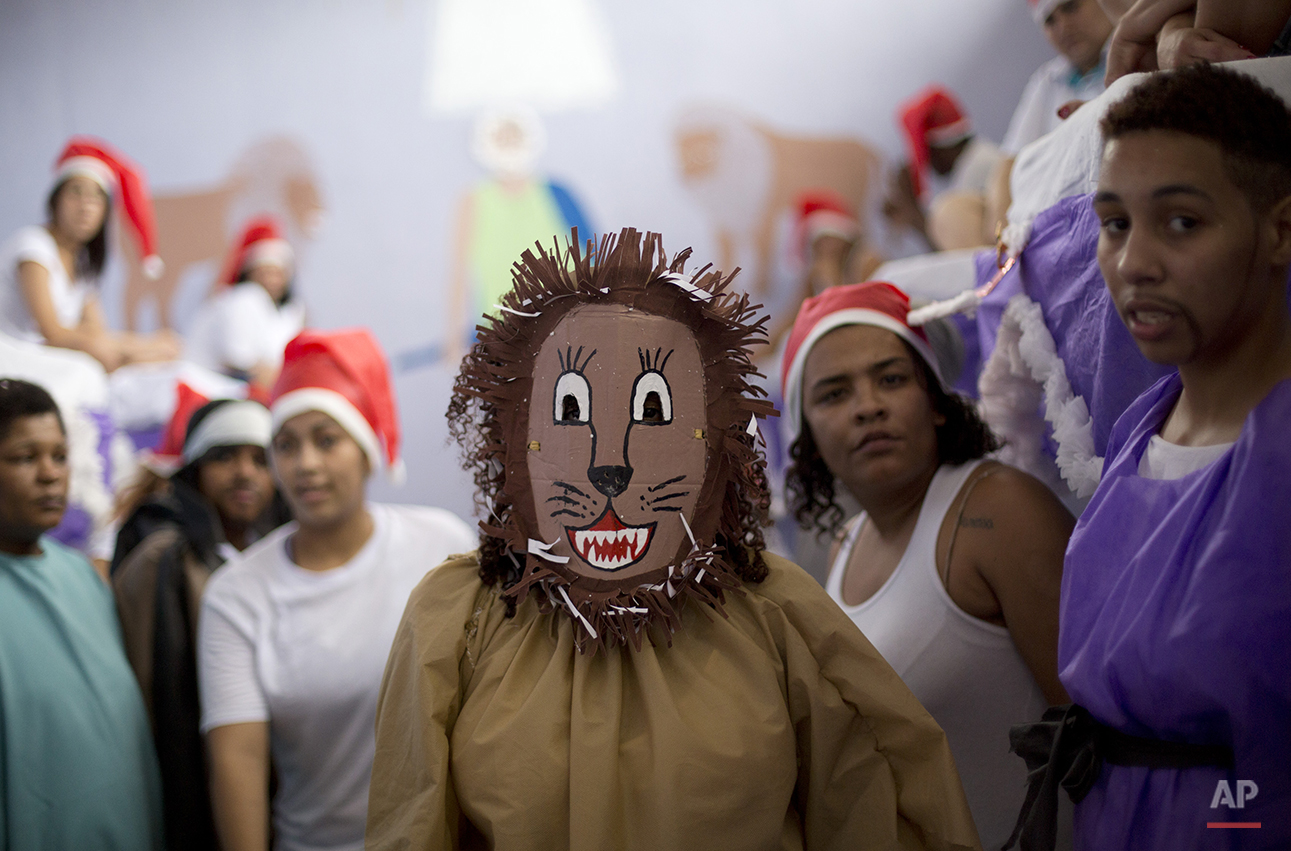 A prisoner dressed as a lion stands amid other prisoners after performing in a Christmas decorating contest inside her cell at the Nelson Hungria prison in Rio de Janeiro, Brazil, Thursday, Dec. 10, 2015. Each cell of 50 women or more also put on a skit dramatizing Biblical stories, with many depictions of Jesus' life, as well as David and Goliath and Daniel in the lions' den, giving prison's would-be thespians their chance to shine. (AP Photo/Silvia Izquierdo)