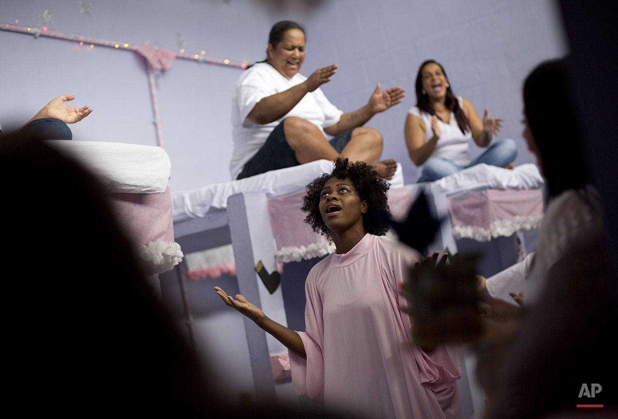 Prisoners perform during a Christmas decorating contest inside their cell at the Nelson Hungria prison in Rio de Janeiro, Brazil, Thursday, Dec. 10, 2015. All of the 531 inmates at the Nelson Hungria prison has her own concrete bunk bed, and the spacious cinderblock cells were free of the overpowering stench, thick clouds of mosquitoes and troops of roaches that are a usually a staple of lockups here. (AP Photo/Silvia Izquierdo)