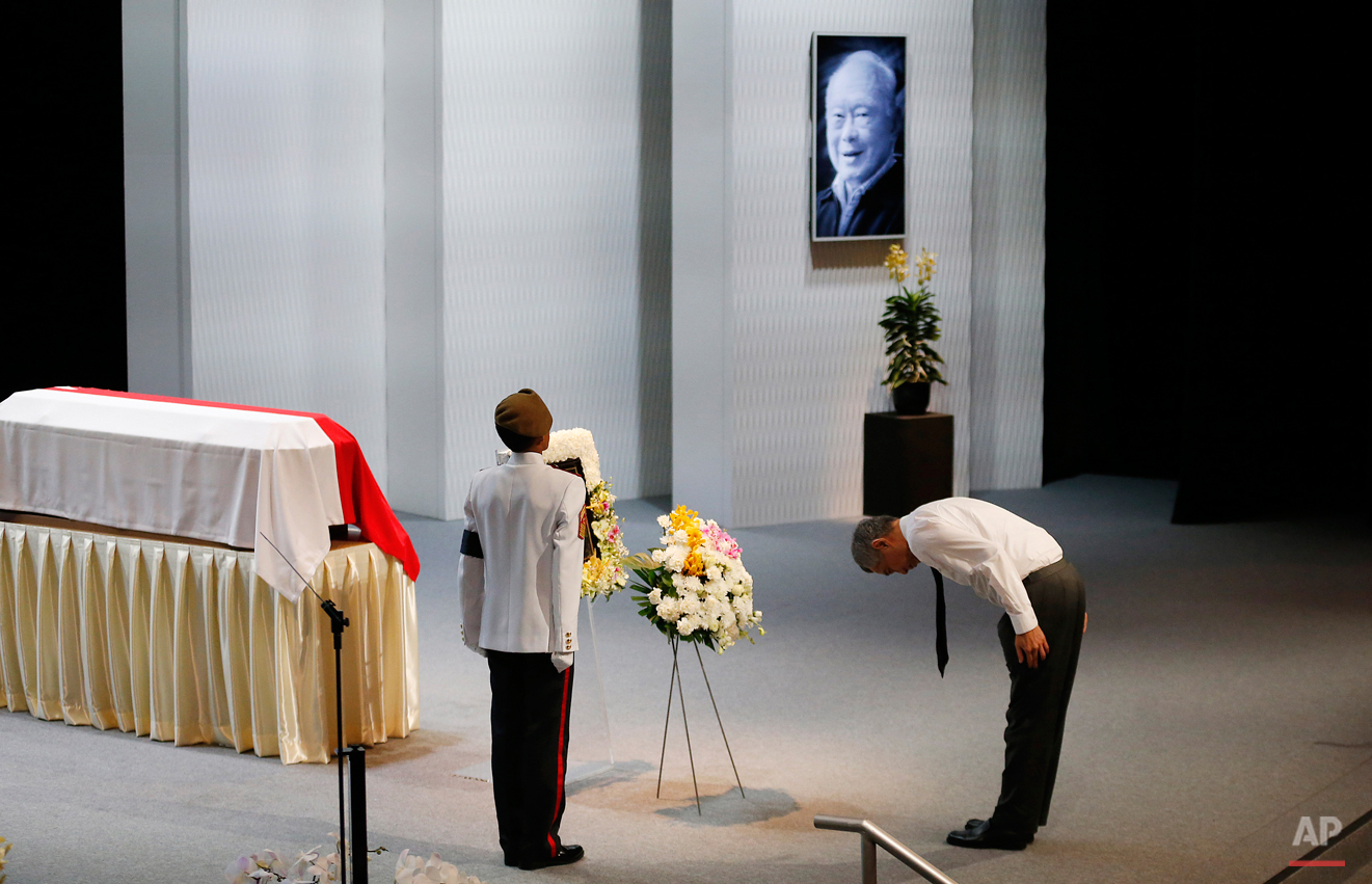 In this Sunday, March 29, 2015, photo, Singapore's Prime Minister Lee Hsien Loong pays his respects during a state funeral of the late Lee Kuan Yew, held at the University Cultural Center, in Singapore. During a week of national mourning that began Monday after Lee's death at age 91, some 450,000 people queued for hours for a glimpse of Lee's coffin at Parliament House. A million people visited tribute sites at community centers across the island and leaders and dignitaries from more than two dozen countries attended the state funeral. (AP Photo/Wong Maye-E)