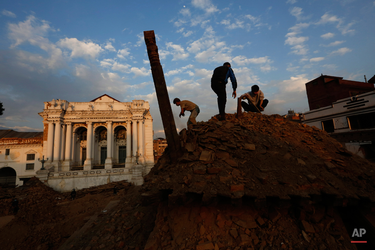 Nepalese students and volunteers clear the rubble at  Kathmandu Durbar Square, a UNESCO World Heritage Site, in Kathmandu, Nepal, Wednesday, April 29, 2015. A 7.8 magnitude earthquake shook Nepal???s capital and the densely populated Kathmandu valley on Saturday devastating the region and leaving tens of thousands shell-shocked and sleeping in streets. (AP Photo/Manish Swarup)