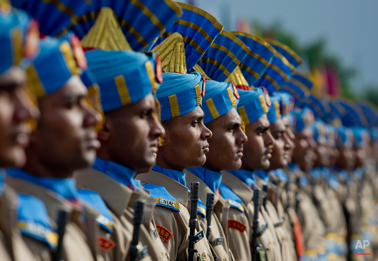 In this Thursday, May 14, 2015, photo, newly recruited members of the Indian Central Reserve Police Force (CRPF) stand during their commencement parade at a base camp on the outskirts of Srinagar, Indian controlled Kashmir. The new soldiers will join the Indian security men fighting separatist Islamic guerrillas in Kashmir and Maoist rebels in different parts of India. (AP Photo/Dar Yasin)