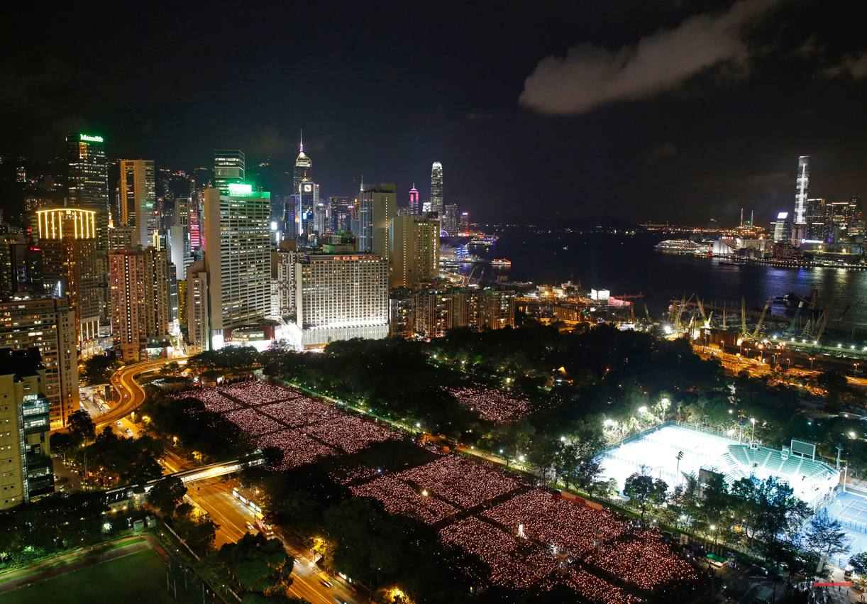 Tens of thousands of people attend a candlelight vigil at Victoria Park in Hong Kong on Thursday, June 4, 2015 to commemorate the 1989 student-led protests in Beijing's Tiananmen Square. (AP Photo/Kin Cheung)