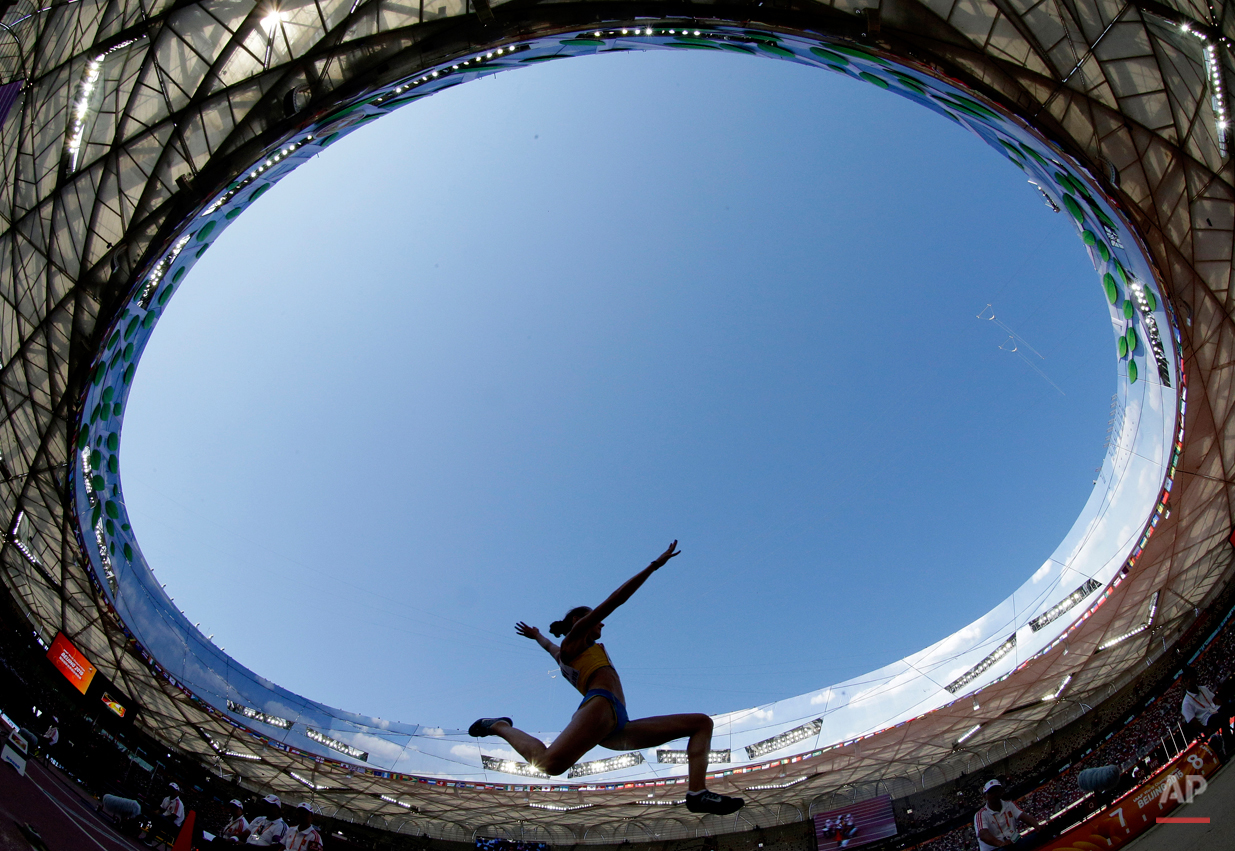 In this Aug. 27, 2015, photo, Sweden's Erica Jarder competes in the women's long jump qualification at the World Athletics Championships at the Bird's Nest stadium in Beijing. (AP Photo/Lee Jin-man)