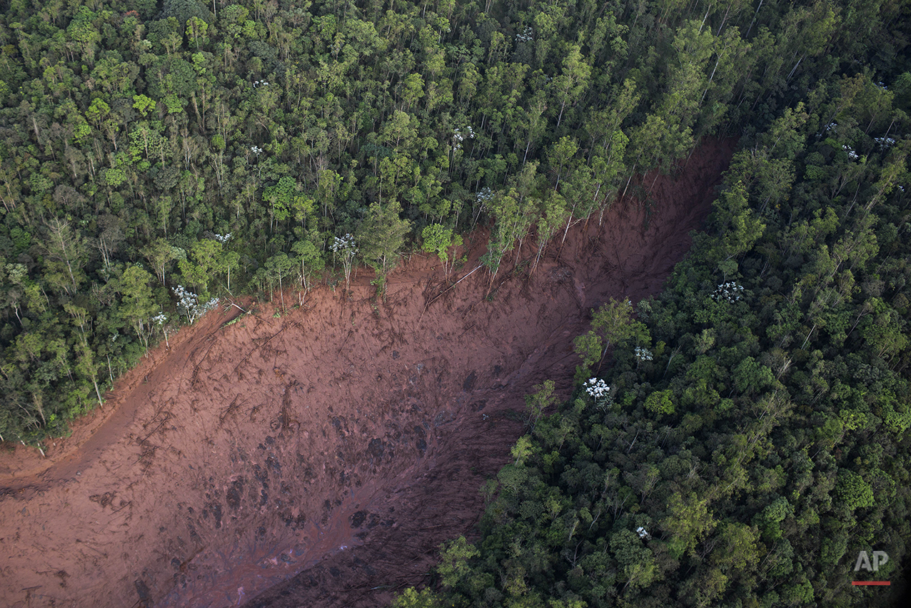 Aerial view of a mudslide after a dam burst on Thursday, at the small town of Bento Rodrigues in Minas Gerais state, Brazil, Friday, Nov. 6, 2015. (AP Photo/Felipe Dana)