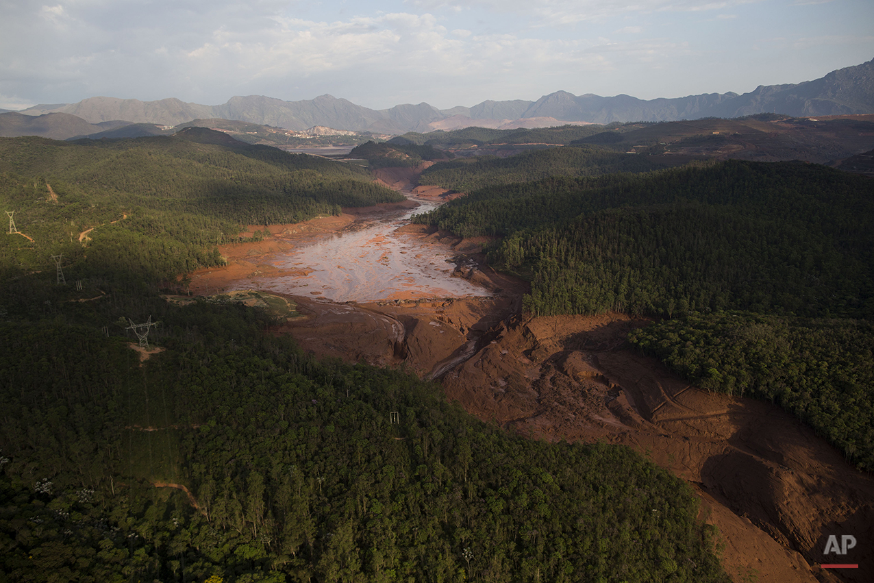 Aerial view of the small town of Bento Rodrigues after a dam burst on Thursday in Minas Gerais state, Brazil, Friday, Nov. 6, 2015. (AP Photo/Felipe Dana)