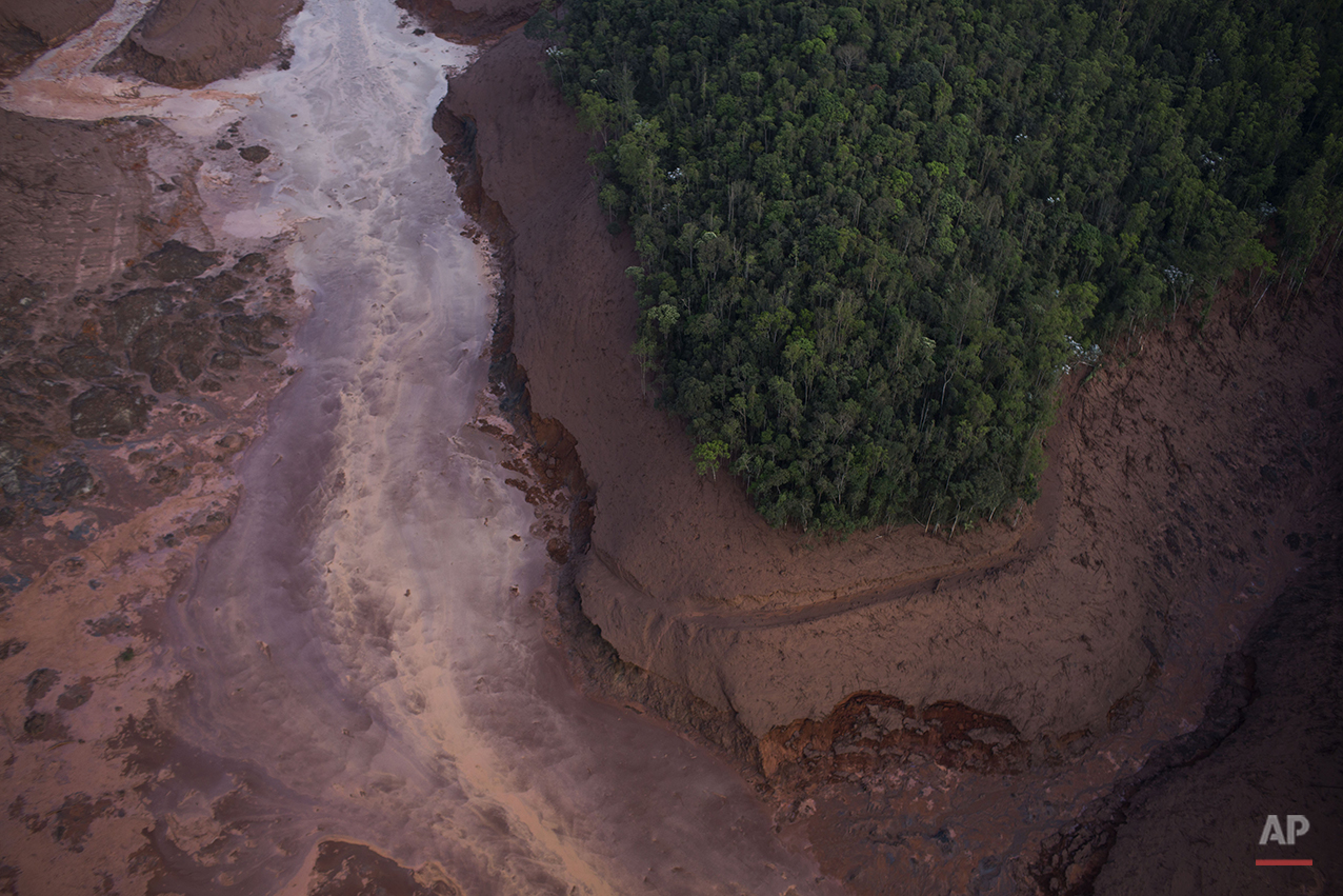 Aerial view of a mudslide after a dam burst at the small town of Bento Rodrigues in Minas Gerais state, Brazil, Friday, Nov. 6, 2015. (AP Photo/Felipe Dana)