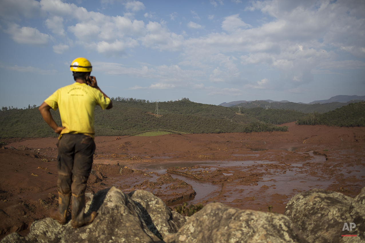 A rescue worker observes the destruction at the small town of Bento Rodrigues after a dam burst on Thursday, in Minas Gerais state, Brazil, Friday, Nov. 6, 2015. (AP Photo/Felipe Dana)