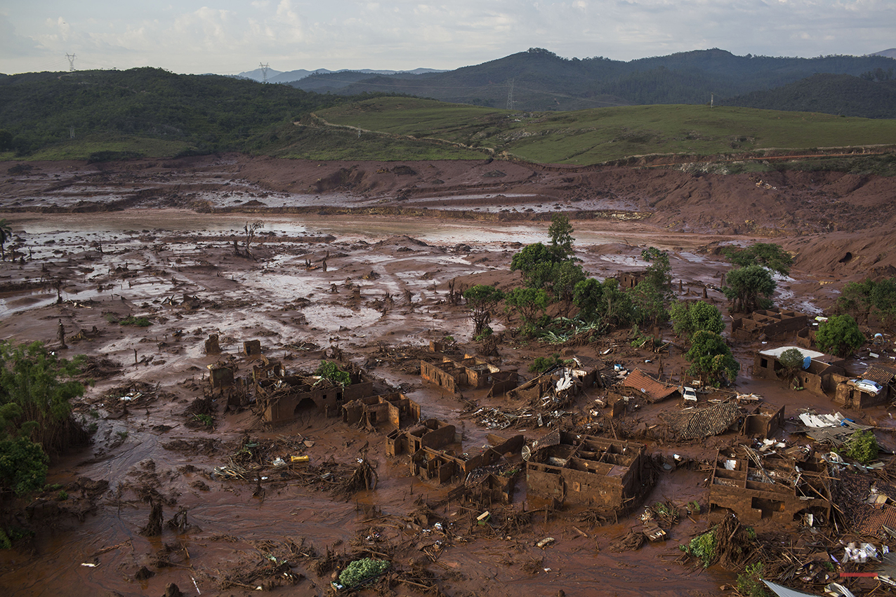 Aerial view of the debris after a dam burst at the small town of Bento Rodrigues in Minas Gerais state, Brazil, Friday, Nov. 6, 2015. (AP Photo/Felipe Dana)
