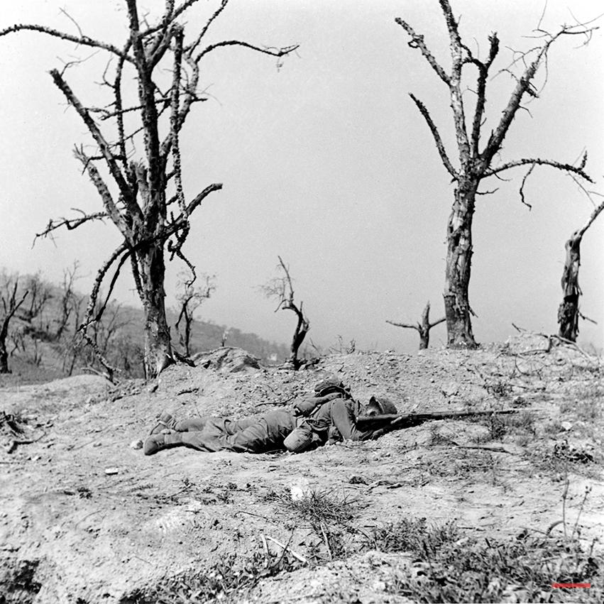 An unidentified American infantryman lies dead in the field of battle, killed by enemy mortar fire during the assault on Santa Maria Infante, Italy, in May 1944 during World War II.  (AP Photo/William C. Allen)