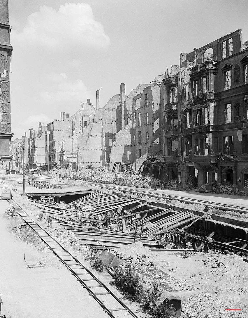 Allied bombing and shelling left this Berlin subway filled with rubble from blasted pavement and buildings on July 19, 1945. (AP Photo/Henry L. Griffin)