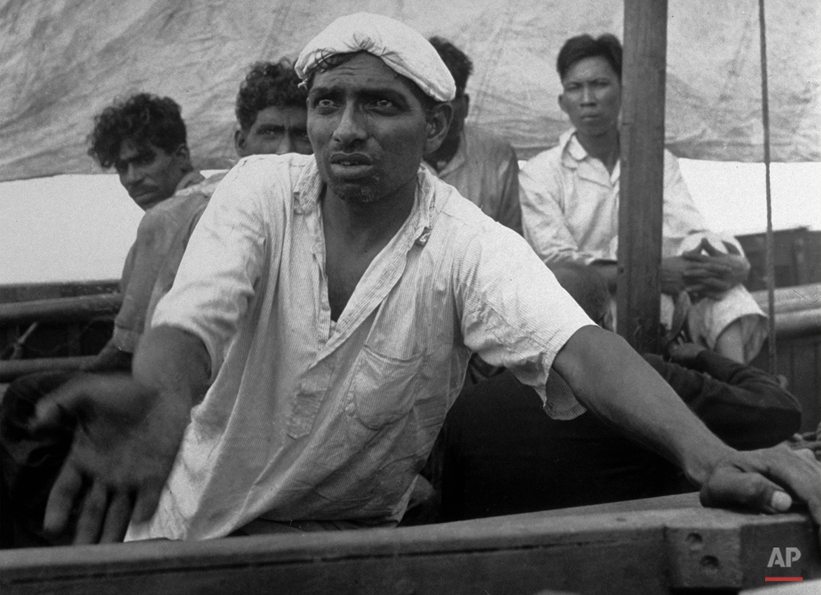 "An Indian sailor pleads for water from a lifeboat adrift on the Indian Ocean in January 1942.  AP photographer Frank ""Pappy"" Noel shot this photo from his own lifeboat after a Japanese torpedo sank a ship carrying Noel, the sailors and others from Singapore.  Noel and his fellow survivors eventually reached Sumatra.  (AP Photo/Frank Noel)"