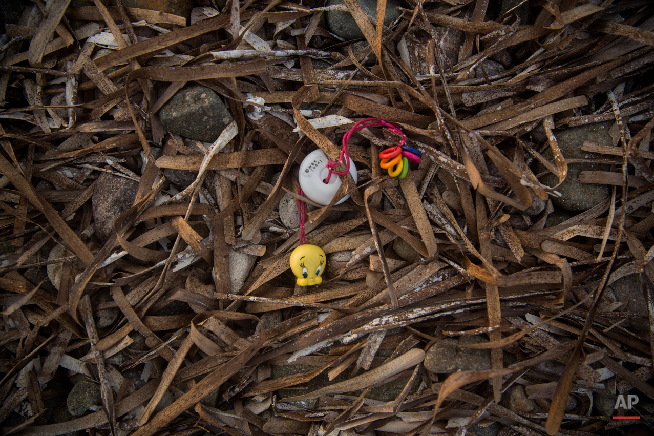In this Monday, Oct. 5, 2015 photo, a children's toy is portrayed on a beach next to the town of Molyvos, on the northeastern Greek island of Lesbos. The migrants arrive by the hundreds on the beaches of the Greek island of Lesbos. And in their eagerness to move on, they leave behind belongings they carried with them.  (AP Photo/Santi Palacios)
