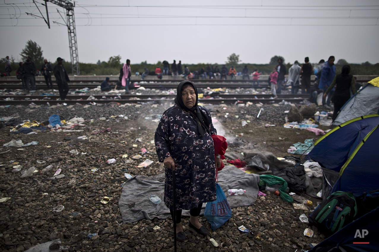 """In this photo taken on Sunday, Sept. 20, 2015, Afghan refugee Bibi Gul Ali, who came from Herat, Afghanistan, poses for a picture while hoping to board a train at the station in Tovarnik, Croatia. """"I am a widow, I am alone I don't know where I am going,"""" she said. (AP Photo/Muhammed Muheisen)"""