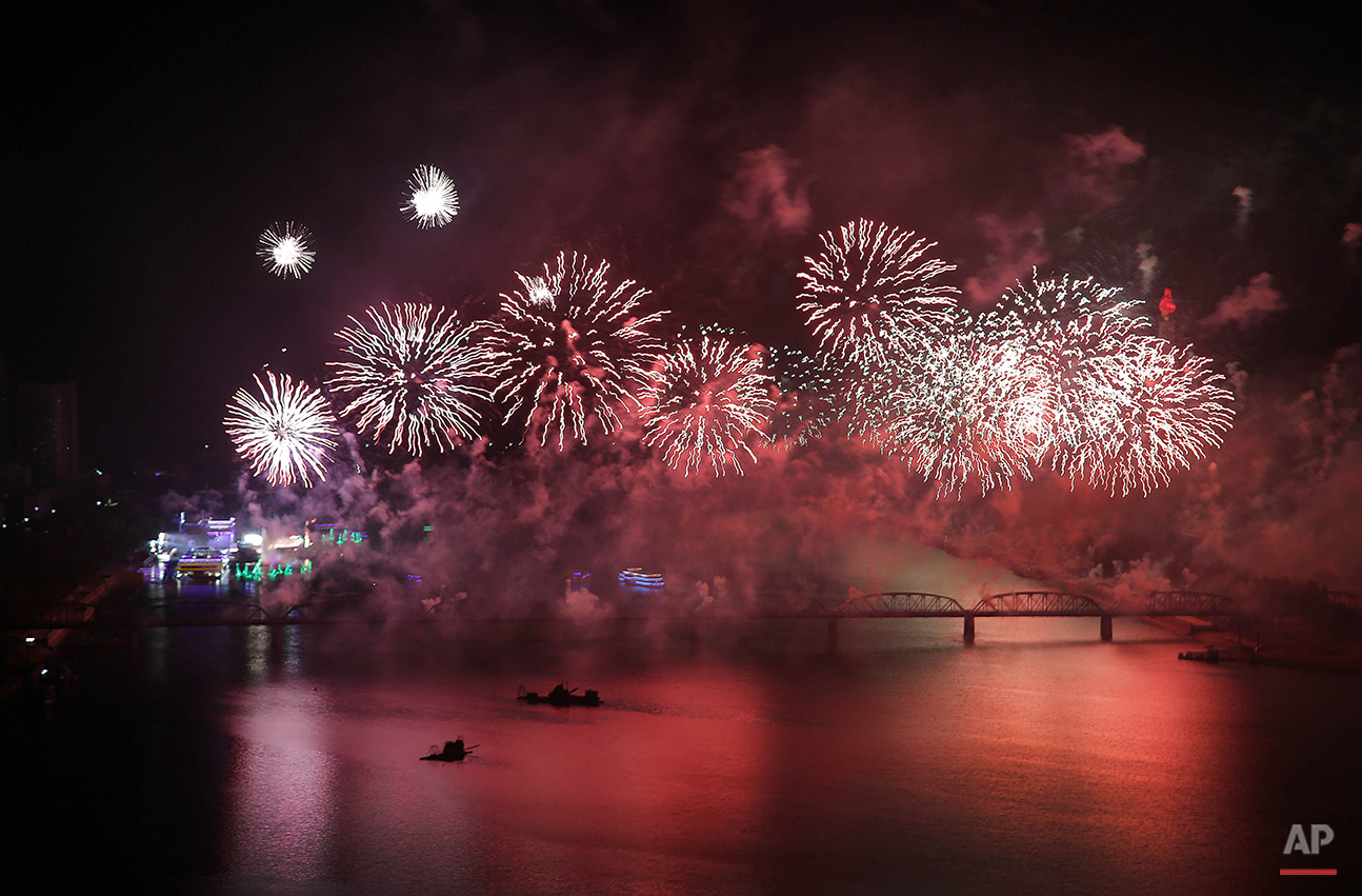 Fireworks explode over the Taedong River as part of 70th anniversary celebrations of the founding of the ruling Workers' Party early Monday, Oct. 12, 2015, in Pyongyang, North Korea. (AP Photo/Wong Maye-E)