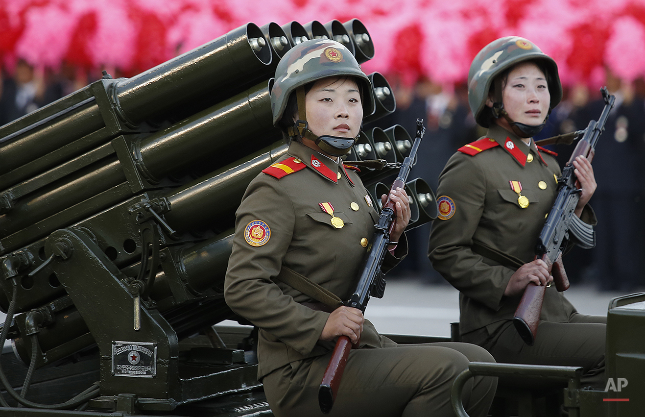 North Korean soldiers parade through Kim Il Sung Square with their missiles and rockets during a mass military parade, Saturday, Oct. 10, 2015, in Pyongyang, North Korea. North Korean leader Kim Jong Un declared Saturday that his country was ready to stand up to any threat posed by the United States as he spoke at a lavish military parade to mark the 70th anniversary of the North's ruling party and trumpet his third-generation leadership. (AP Photo/Wong Maye-E)