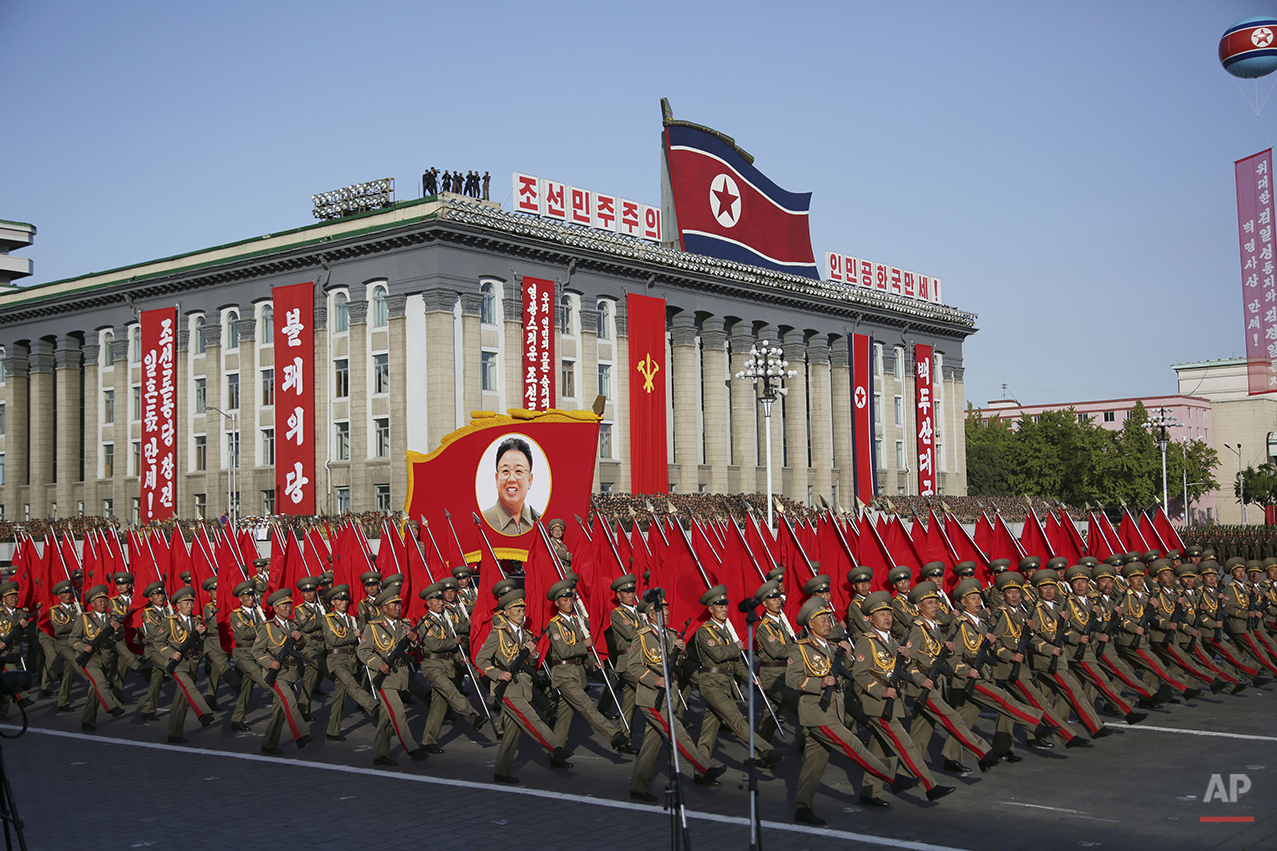 North Korean soldiers march beneath a portrait of late leader Kim Jong Il as they parade in Pyongyang, North Korea, Saturday, Oct. 10, 2015. North Korean leader Kim Jong Un declared Saturday that his country was ready to stand up to any threat posed by the United States as he spoke at a lavish military parade to mark the 70th anniversary of the North's ruling party and trumpet his third-generation leadership. (AP Photo/Wong Maye-E)