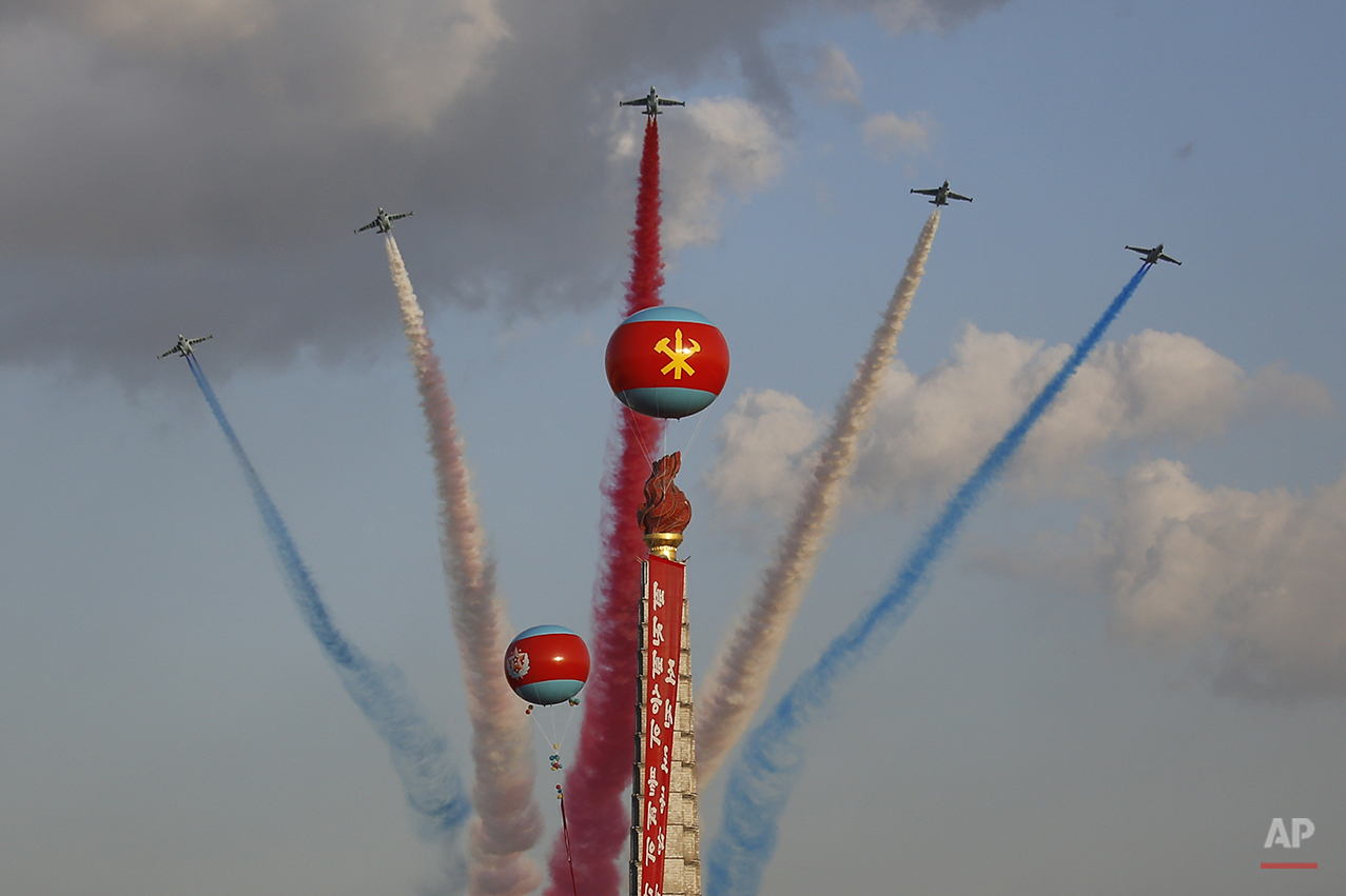 Jets fly over the Juche Tower during a parade on the Kim Il Sung Square, Saturday, Oct. 10, 2015, in Pyongyang, North Korea. North Korean leader Kim Jong Un declared Saturday that his country was ready to stand up to any threat posed by the United States as he spoke at a lavish military parade to mark the 70th anniversary of the North's ruling party and trumpet his third-generation leadership.(AP Photo/Wong Maye-E)