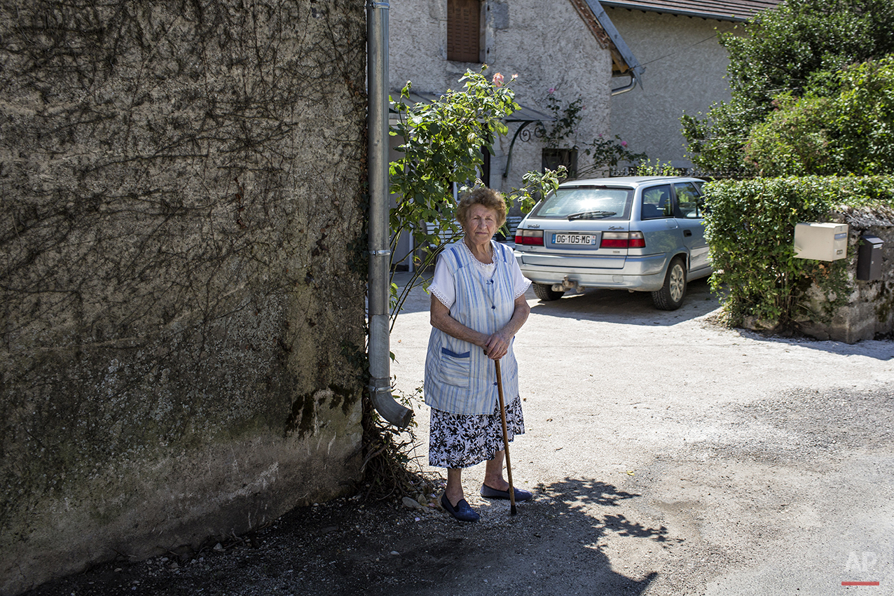 during the eleventh stage of the 101st edition of the Tour de France, between Besancon and Oyonnax, France, Wednesday, July 16, 2014. (AP Photo/Laurent Cipriani)