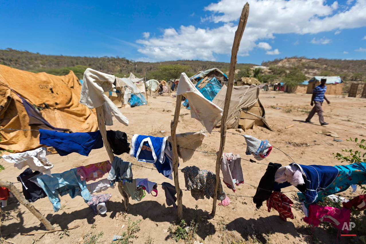 In this Aug. 3, 2015 photo, clothes hang to dry in a camp set up by Haitians who either fled from or were deported from the Dominican Republic in Anse-a-Pitres, Haiti on the border with the D.R. The Haitian government has warned that the camps are becoming a crisis and has threatened to remove at least some of the people. However, some people in the camps, say they have nowhere else to go. (AP Photo/Dieu Nalio Chery)