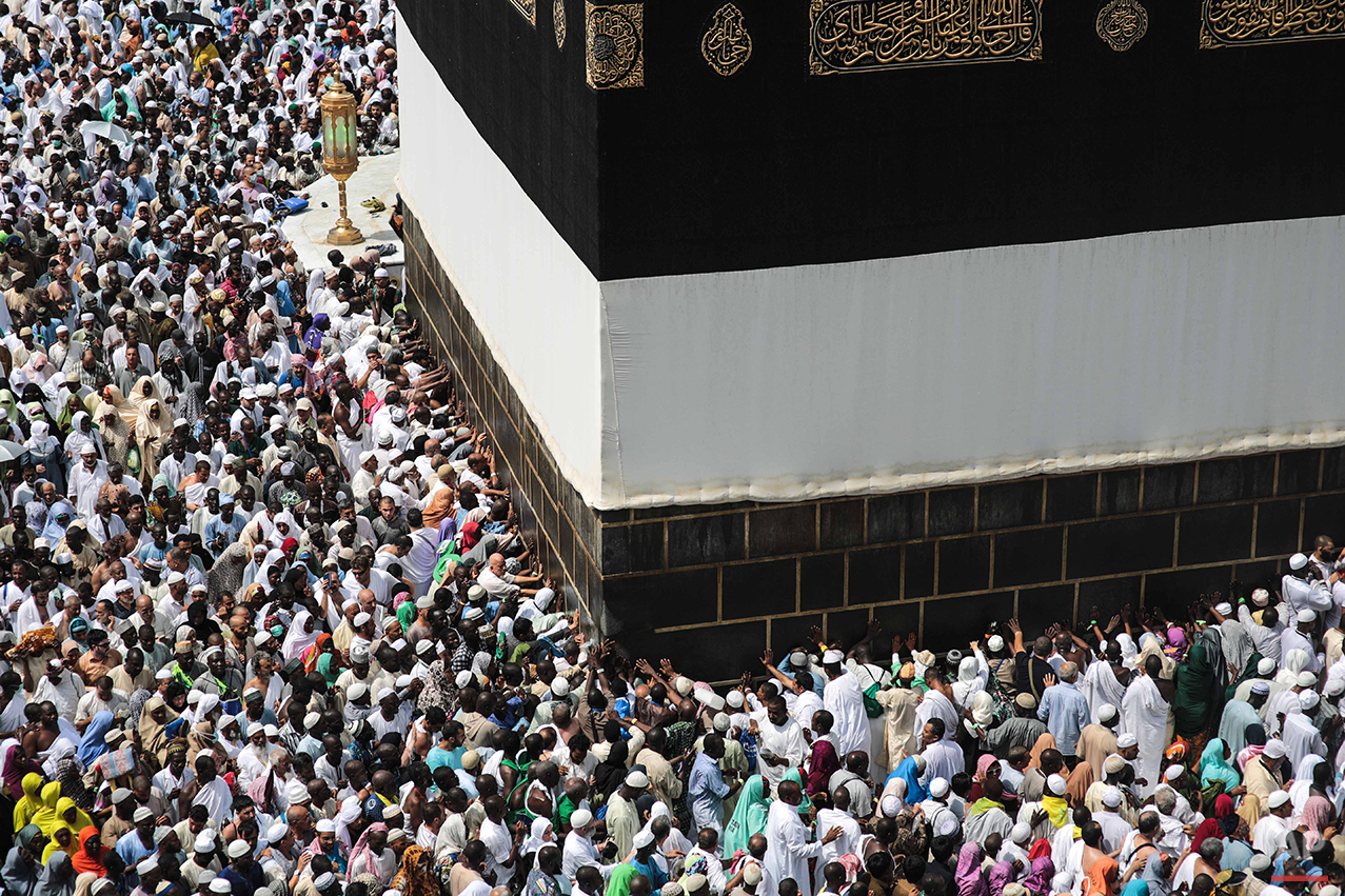 Muslim pilgrims circle the Kaaba, the cubic building at the Grand Mosque in the Muslim holy city of Mecca, Saudi Arabia, Sunday, Sept. 20, 2015. More than 1 million pilgrims have already arrived for the annual hajj pilgrimage, which is required of every Muslim who can afford it and is physically able to make it. (AP Photo/Mosa'ab Elshamy)