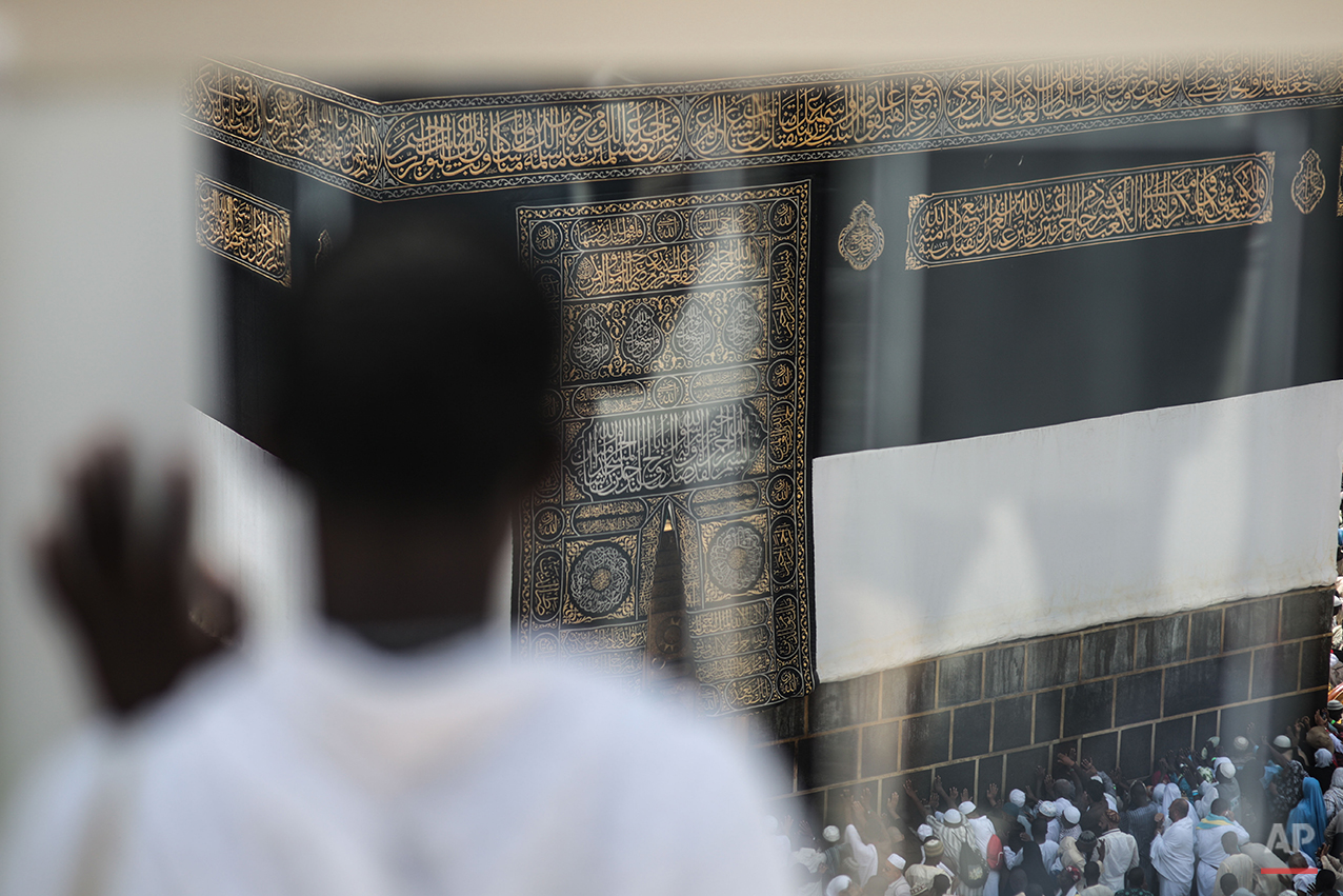 A Muslim pilgrims prays while facing the Kaaba, the cubic building at the Grand Mosque in the Muslim holy city of Mecca, Saudi Arabia, Sunday, Sept. 20, 2015. More than 1 million pilgrims have already arrived for the annual hajj pilgrimage, which is required of every Muslim who can afford it and is physically able to make it. (AP Photo/Mosa'ab Elshamy)