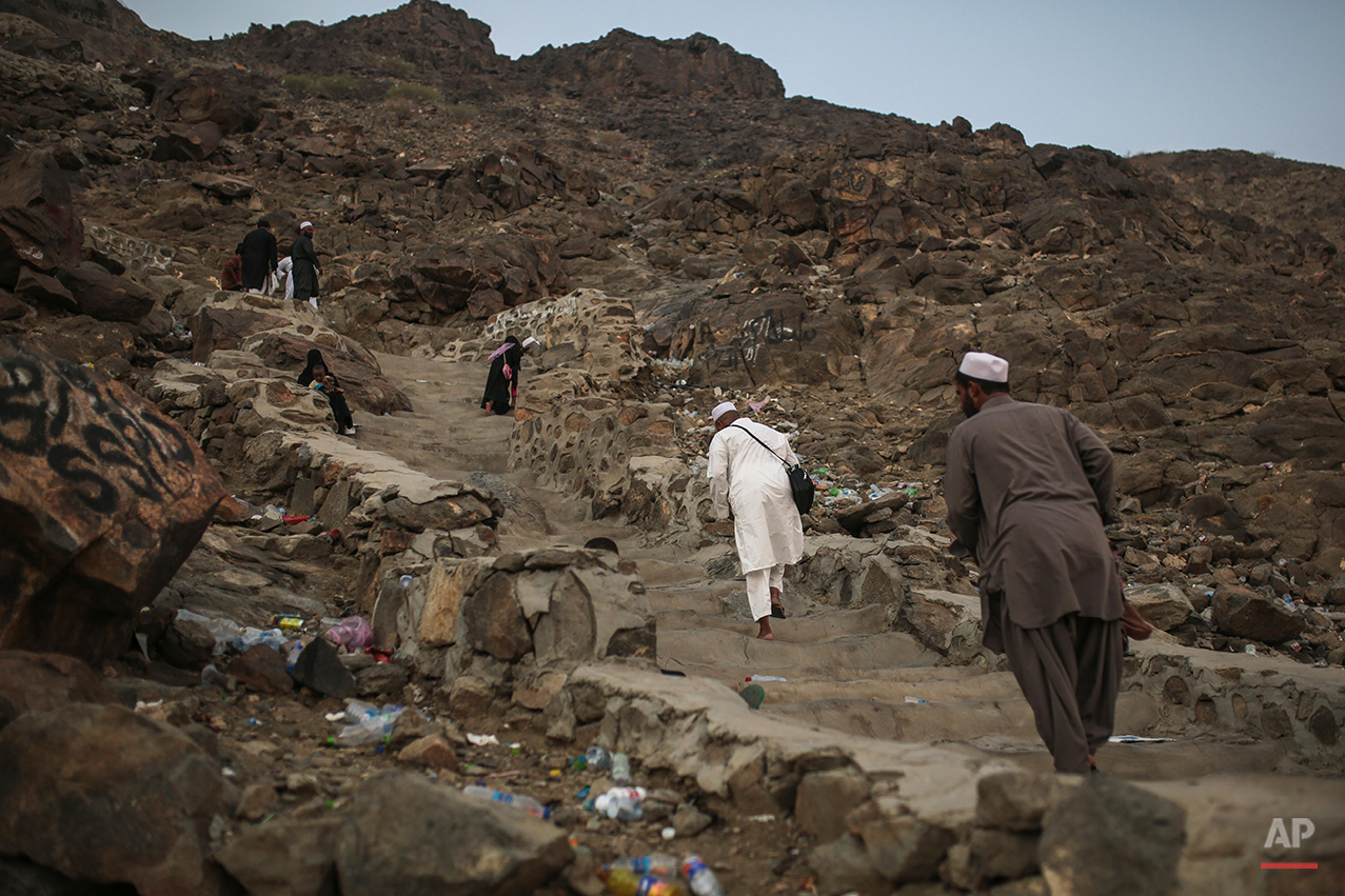 Muslim pilgrims climb the Noor Mountain to the Hiraa cave, where Prophet Muhammad received his first revelation from God to preach Islam, on the outskirts of Mecca, Saudi Arabia, Friday, Sept. 18, 2015. Hajj is expected to start on Monday. More than 1 million pilgrims have already arrived for the annual pilgrimage, which all able-bodied Muslims are required to perform once in their lives.  (AP Photo/Mosa'ab Elshamy)