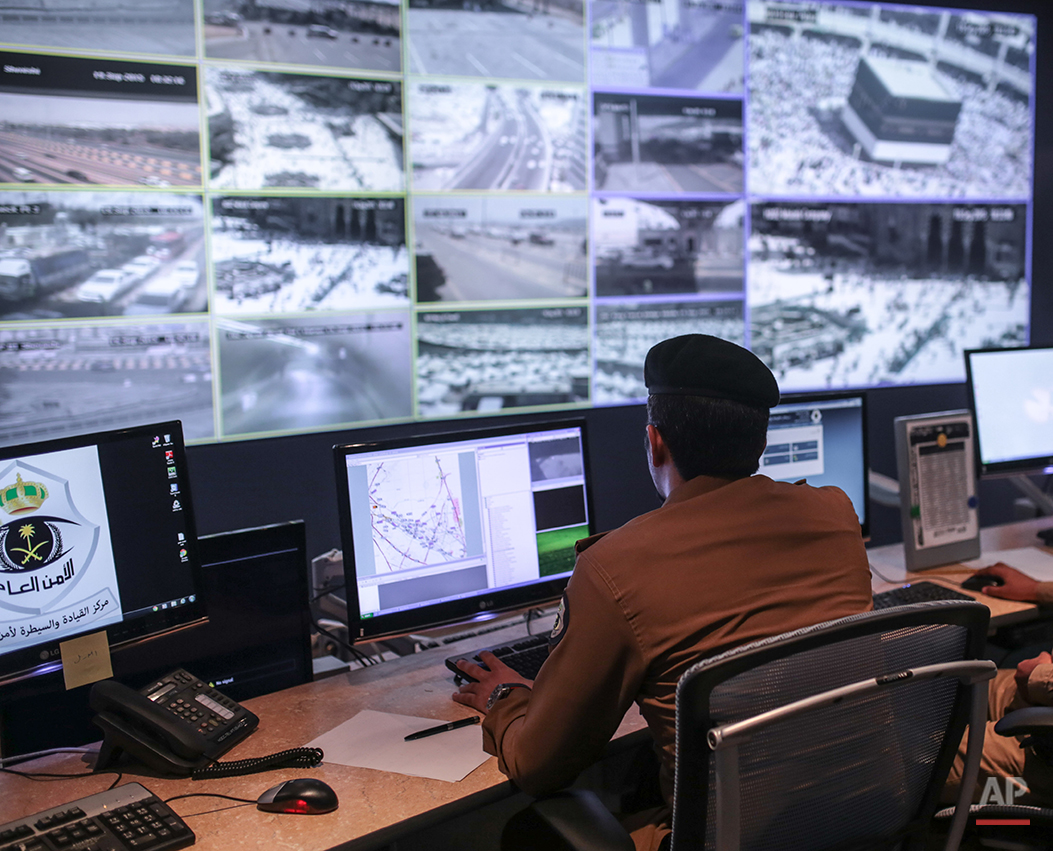 A Saudi security officer monitors screens with live views of Muslim pilgrims in the holy city of Mecca, along with highways and high density areas, a few days before the start of the annual pilgrimage, known as the hajj, in Mecca, Saudi Arabia, Saturday, Sept. 19, 2015. (AP Photo/Mosa'ab Elshamy)
