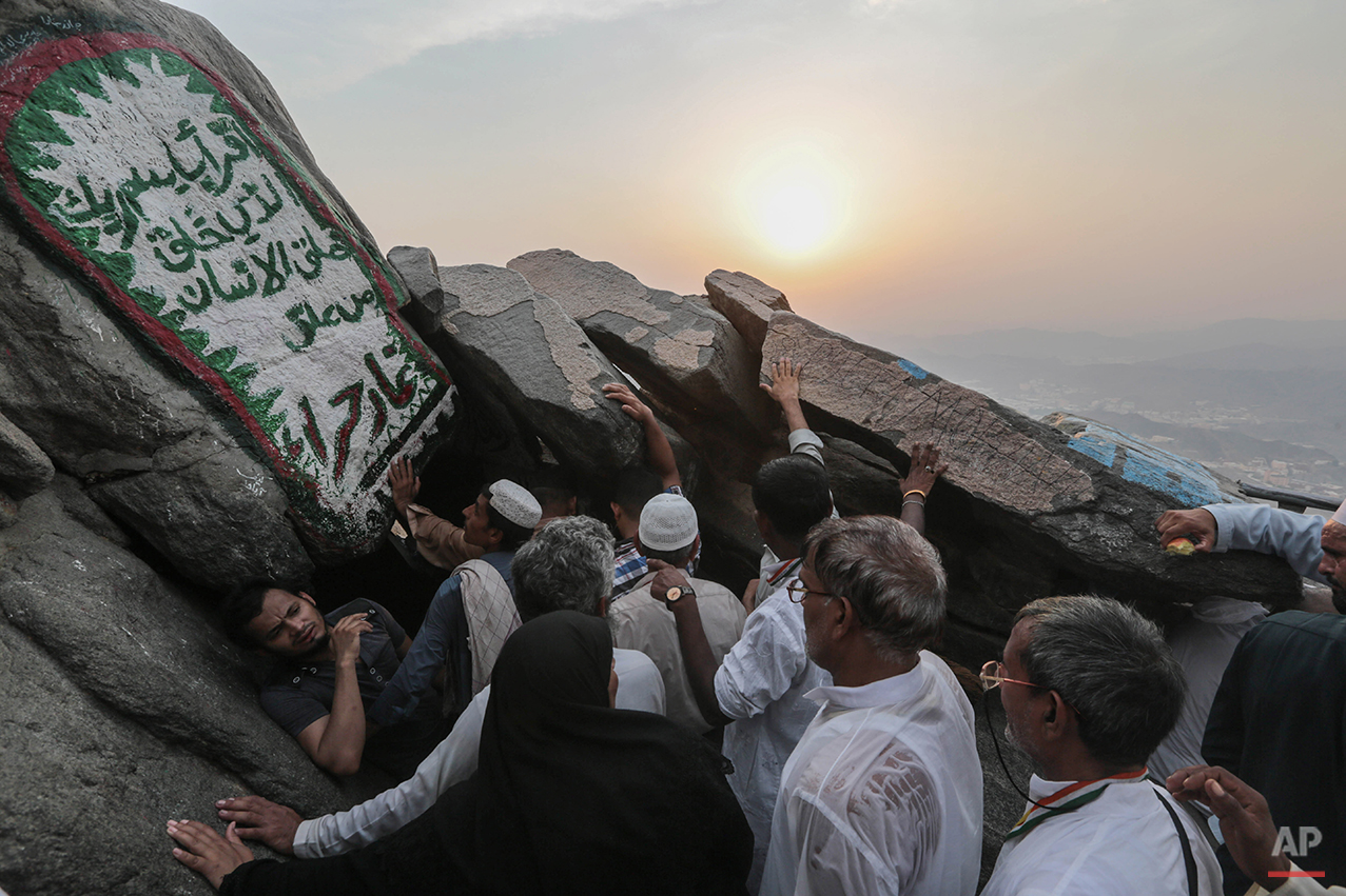 Muslim pilgrims queue atop Noor Mountain outside the Hiraa cave, where Prophet Muhammad received his first revelation from God to preach Islam, on the outskirts of Mecca, Saudi Arabia, Friday, Sept. 18, 2015. Hajj is expected to start on Monday. More than 1 million pilgrims have already arrived for the annual pilgrimage, which all able-bodied Muslims are required to perform once in their lives. (AP Photo/Mosa'ab Elshamy)