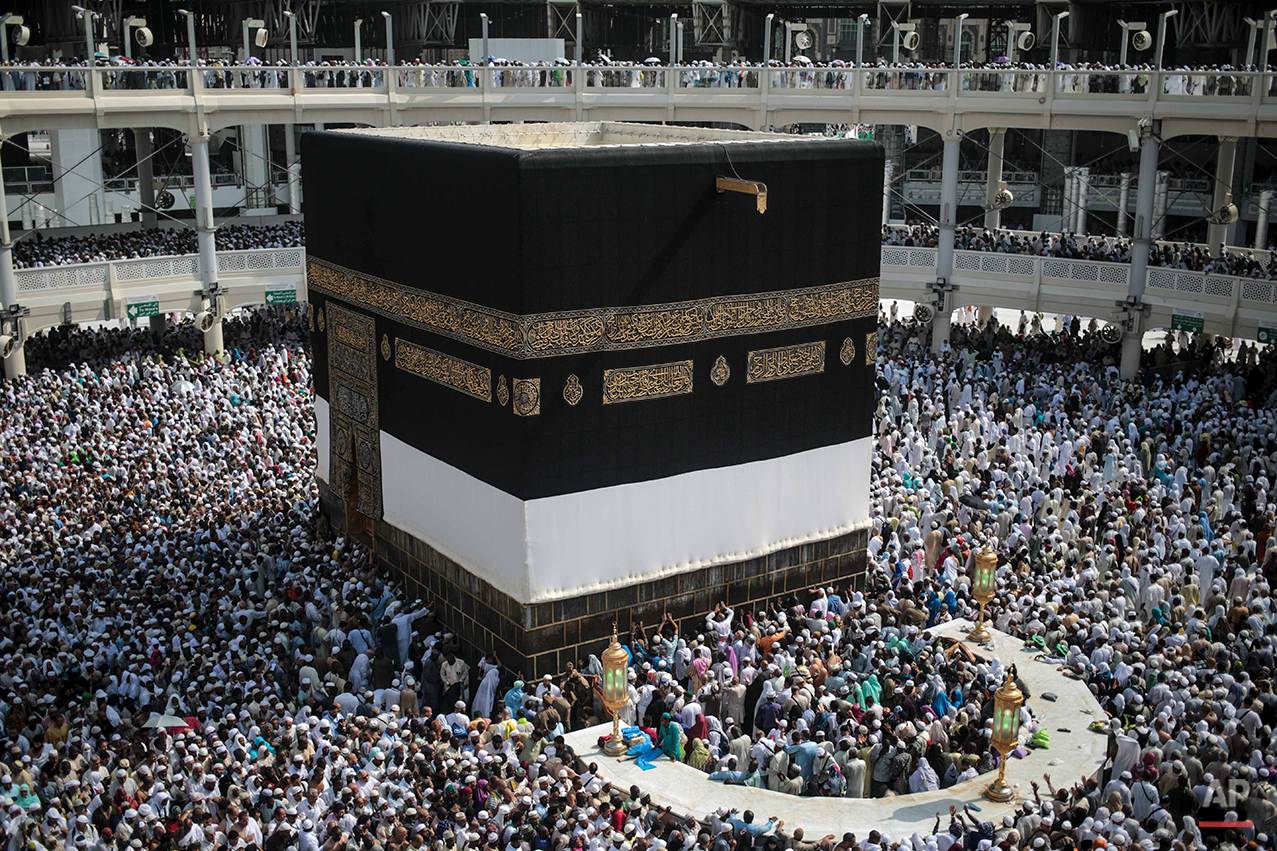 Muslim pilgrims circle the Kaaba, the cubic building at the Grand Mosque in the Muslim holy city of Mecca, Saudi Arabia, Tuesday, Sept. 15, 2015. Despite the crane accident on Friday, almost one million pilgrims have arrived as of Tuesday ahead of the hajj. (AP Photo/Mosa'ab Elshamy)
