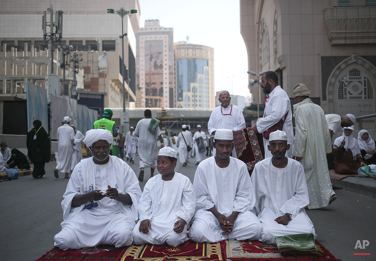 Muslim Pilgrims prepare for Friday afternoon prayers outside the Grand Mosque in the holy city of Mecca, Saudi Arabia, Friday, Sep. 18, 2015. The hajj is expected to start on Monday. More than 1 million pilgrims have already arrived for the annual pilgrimage, which all able-bodied Muslims are required to perform once in their lives. (AP Photo/Mosa'ab Elshamy)