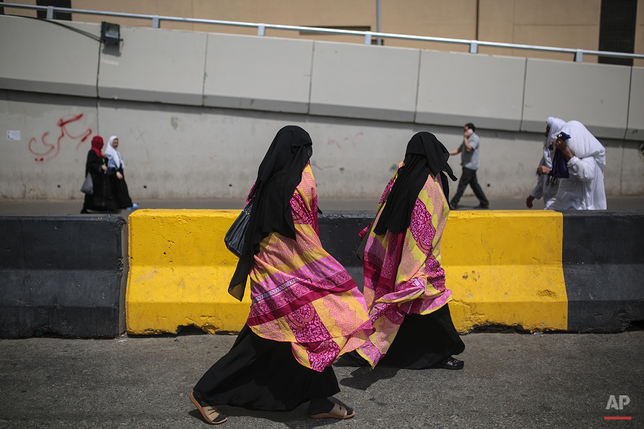 Muslim Pilgrims walk towards the Grand Mosque to attend afternoon prayers in the holy city of Mecca, Saudi Arabia, Sunday, Sep. 20, 2015. More than 1 million pilgrims have already arrived for the annual pilgrimage, which is required of every Muslim who can afford it and is physically able to make it. (AP Photo/Mosa'ab Elshamy)