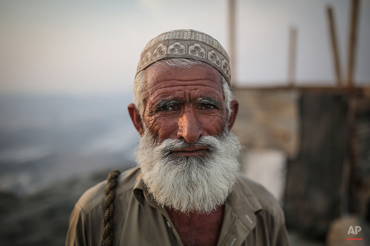 A Muslim pilgrims poses for a photograph as he climbs Noor Mountain to Hiraa cave, where Prophet Muhammad received his first revelation from God to preach Islam, on the outskirts of Mecca, Saudi Arabia, Friday, Sept. 18, 2015. Hajj is expected to start on Monday. More than 1 million pilgrims have already arrived for the annual pilgrimage, which all able-bodied Muslims are required to perform once in their lives.  (AP Photo/Mosa'ab Elshamy)