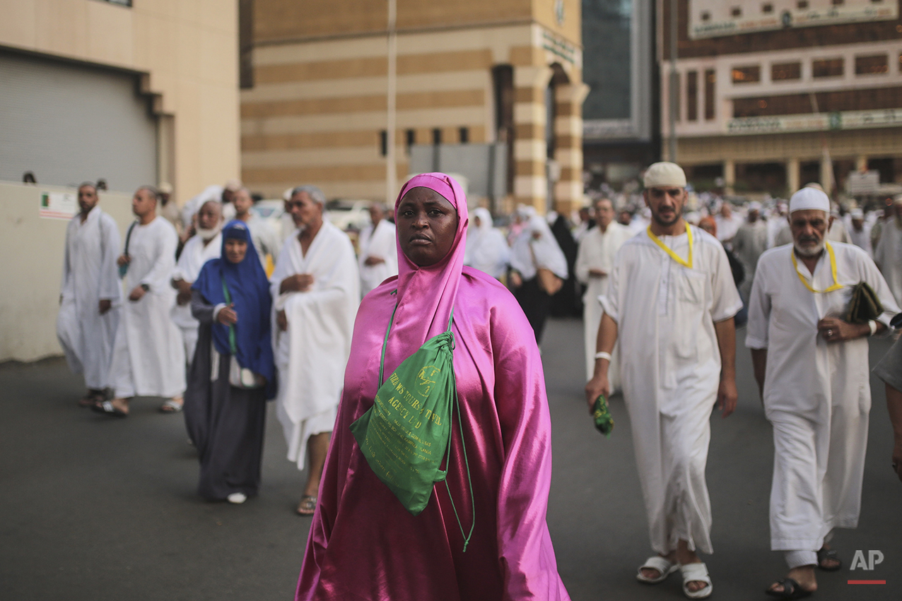 A Muslim pilgrim walks outside the Grand Mosque in the holy city of Mecca, Saudi Arabia, Sunday, Sept. 20, 2015. Roughly 3 million people from around the world are expected to converge at the Kaaba, in Mina and other nearby areas for the hajj, which lasts about five days. All able-bodied Muslims are required to perform once in their lives. (AP Photo/Mosa'ab Elshamy)