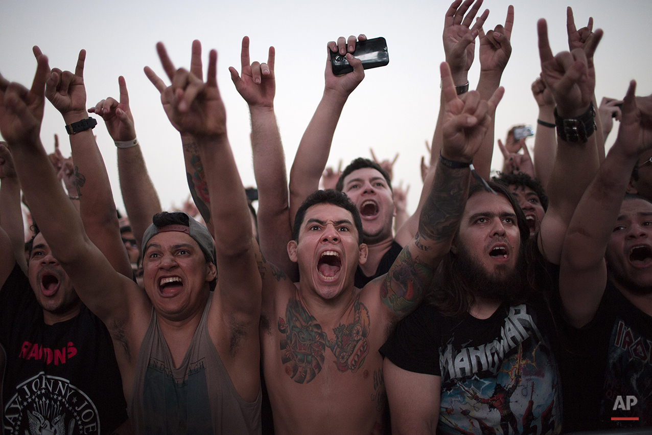Fans shout out during the presentation of the heavy metal group Lamb of God at the Rock in Rio music festival in Rio de Janeiro, Brazil, Thursday, Sept. 24, 2015. (AP Photo/Leo Correa)