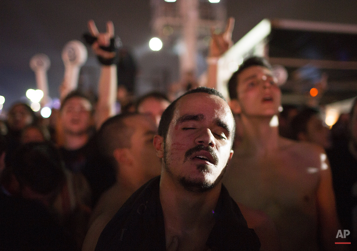 A fan listens the music with the eyes closed during the performance of Slipknot at the Rock in Rio music festival in Rio de Janeiro, Brazil, Friday, Sept. 25, 2015. (AP Photo/Leo Correa)