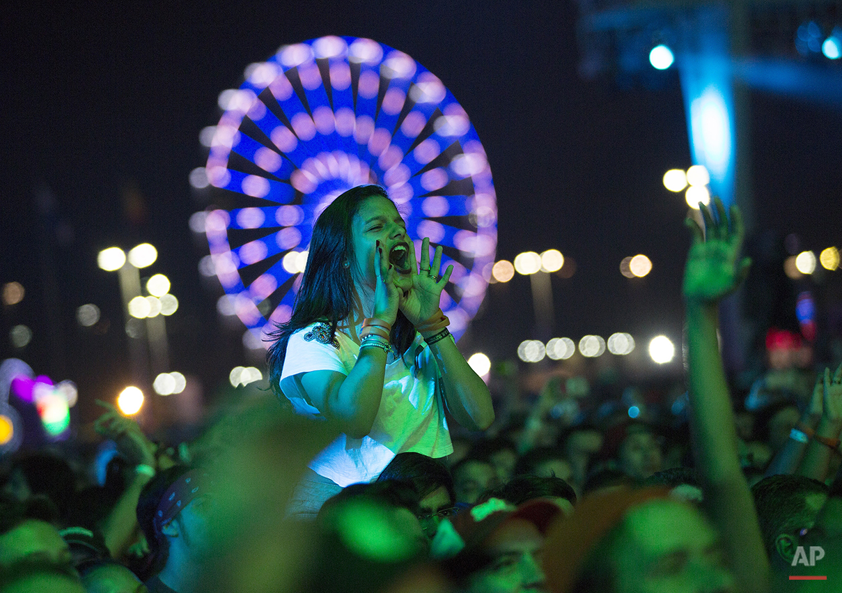 A fan shouts out during the performance of Brazilian rock group Paralamas do Sucesso at the Rock in Rio music festival in Rio de Janeiro, Brazil, Sunday, Sept. 20, 2015. (AP Photo/Leo Correa)