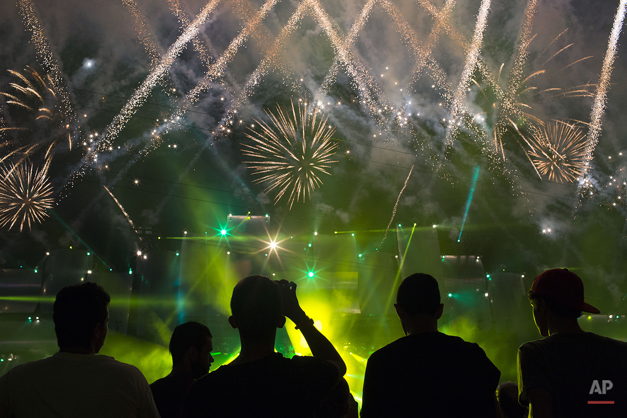 Fireworks light up the sky before the opening show of the Rock in Rio music festival in Rio de Janeiro, Brazil, Friday, Sept. 18, 2015. Some of the performers invited to perform in this year's festival are the reunited Faith No More, System of a Down, Queens of the Stone Age, Slipknot, Metallica, Elton John, Motley Crue, Rod Stewart, Elton John, and Seal. (AP Photo/Felipe Dana)